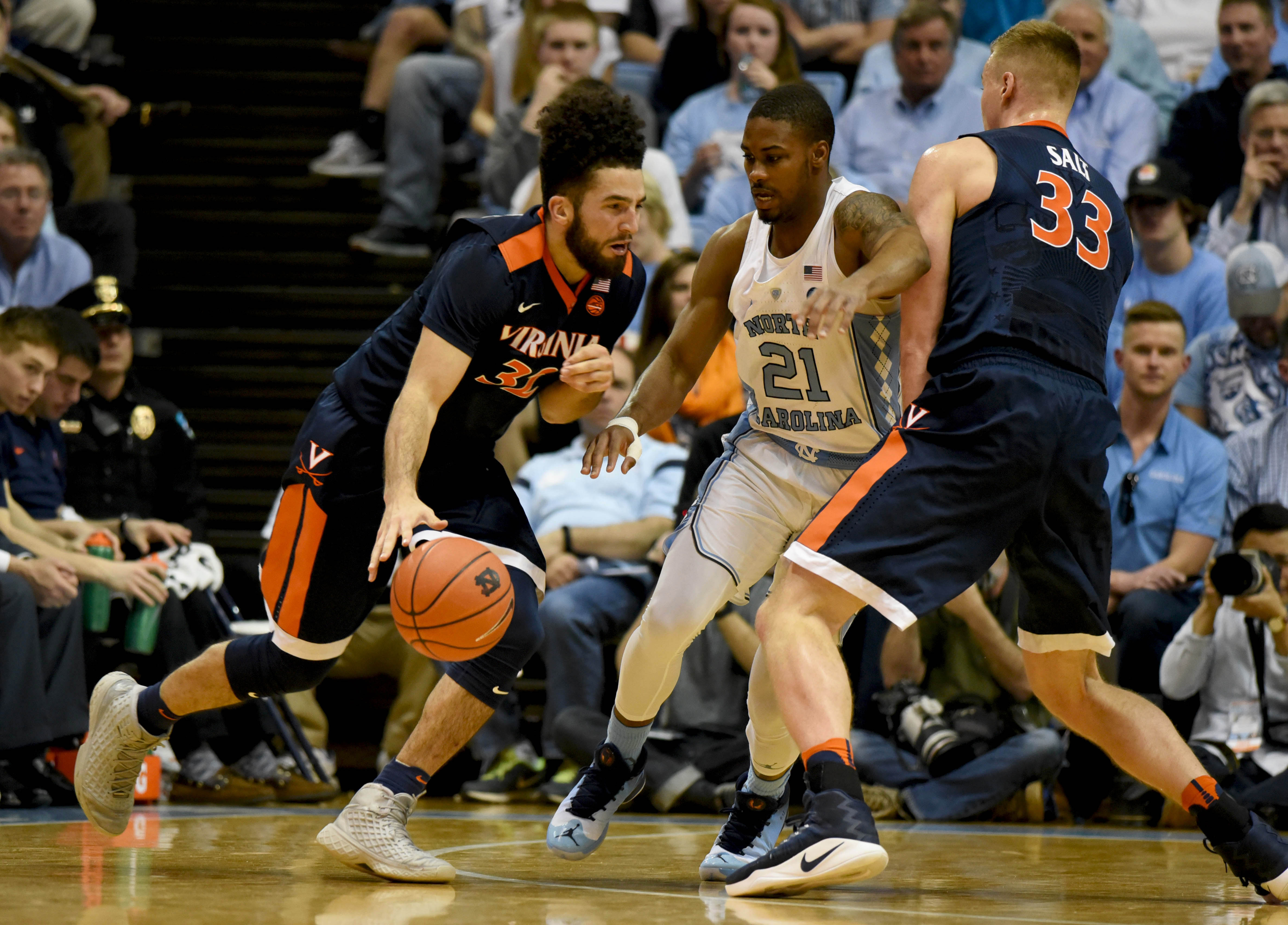 9886652-ncaa-basketball-virginia-at-north-carolina