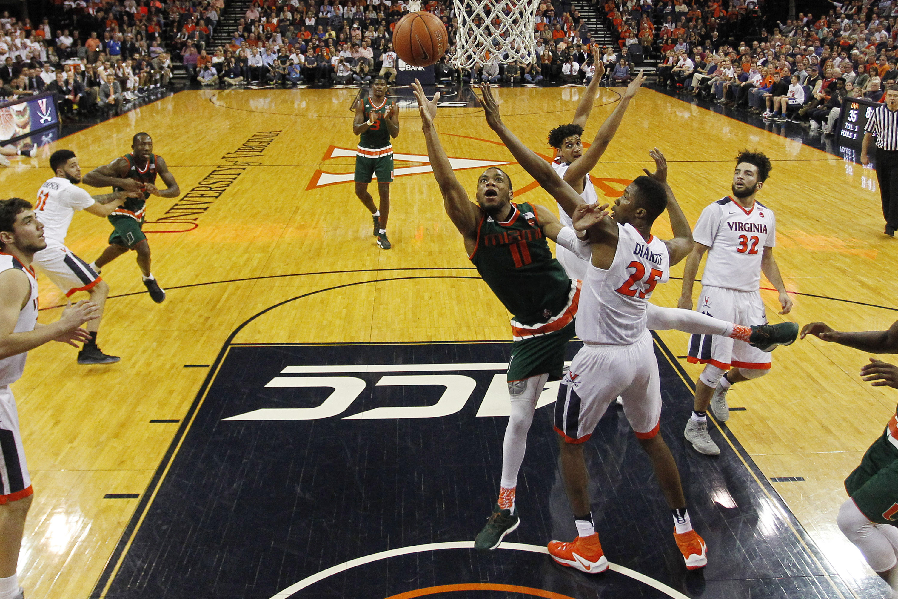 9890210-ncaa-basketball-miami-at-virginia