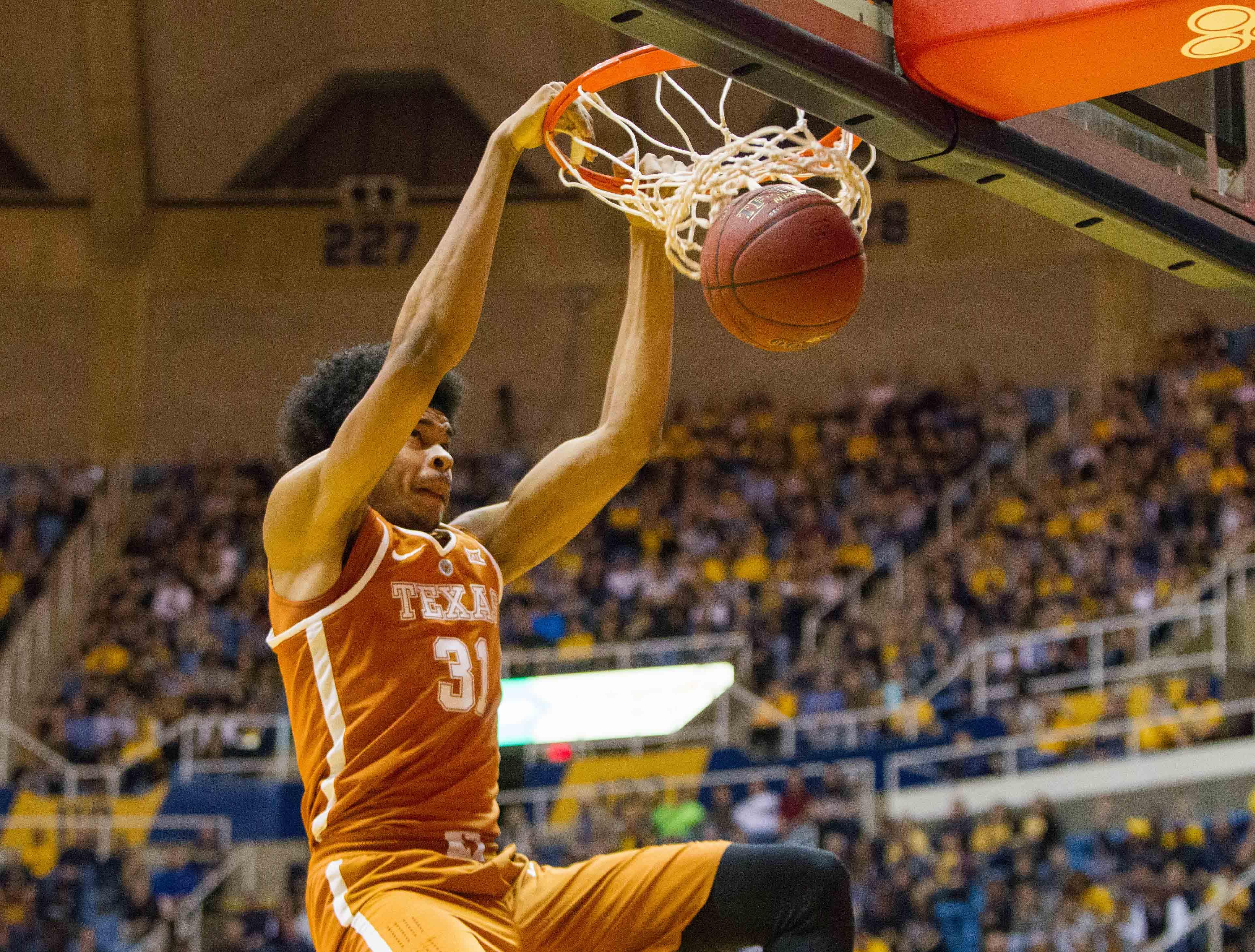 9911681-ncaa-basketball-texas-at-west-virginia-1