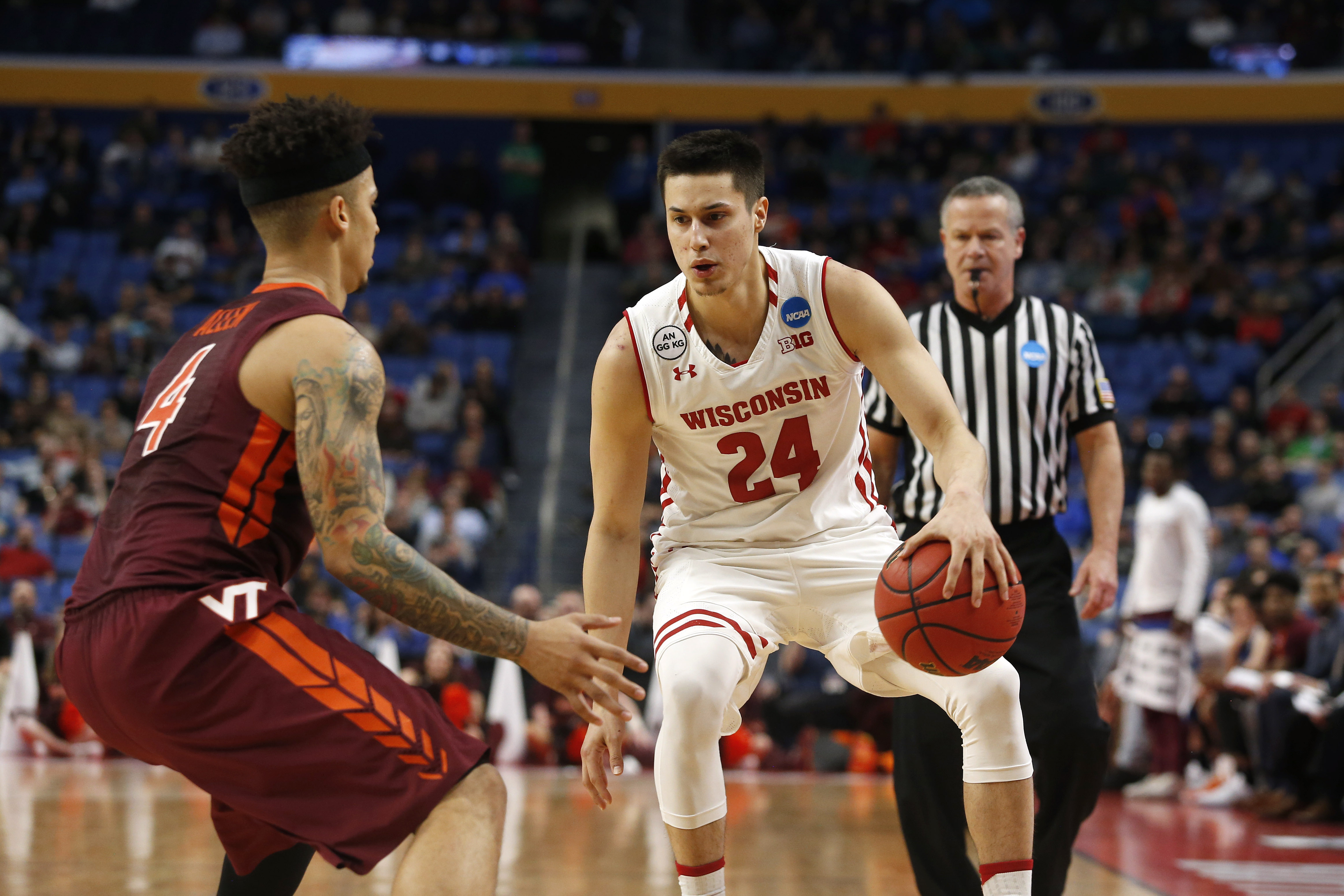 9949061-ncaa-basketball-ncaa-tournament-first-round-virginia-tech-vs-wisconsin