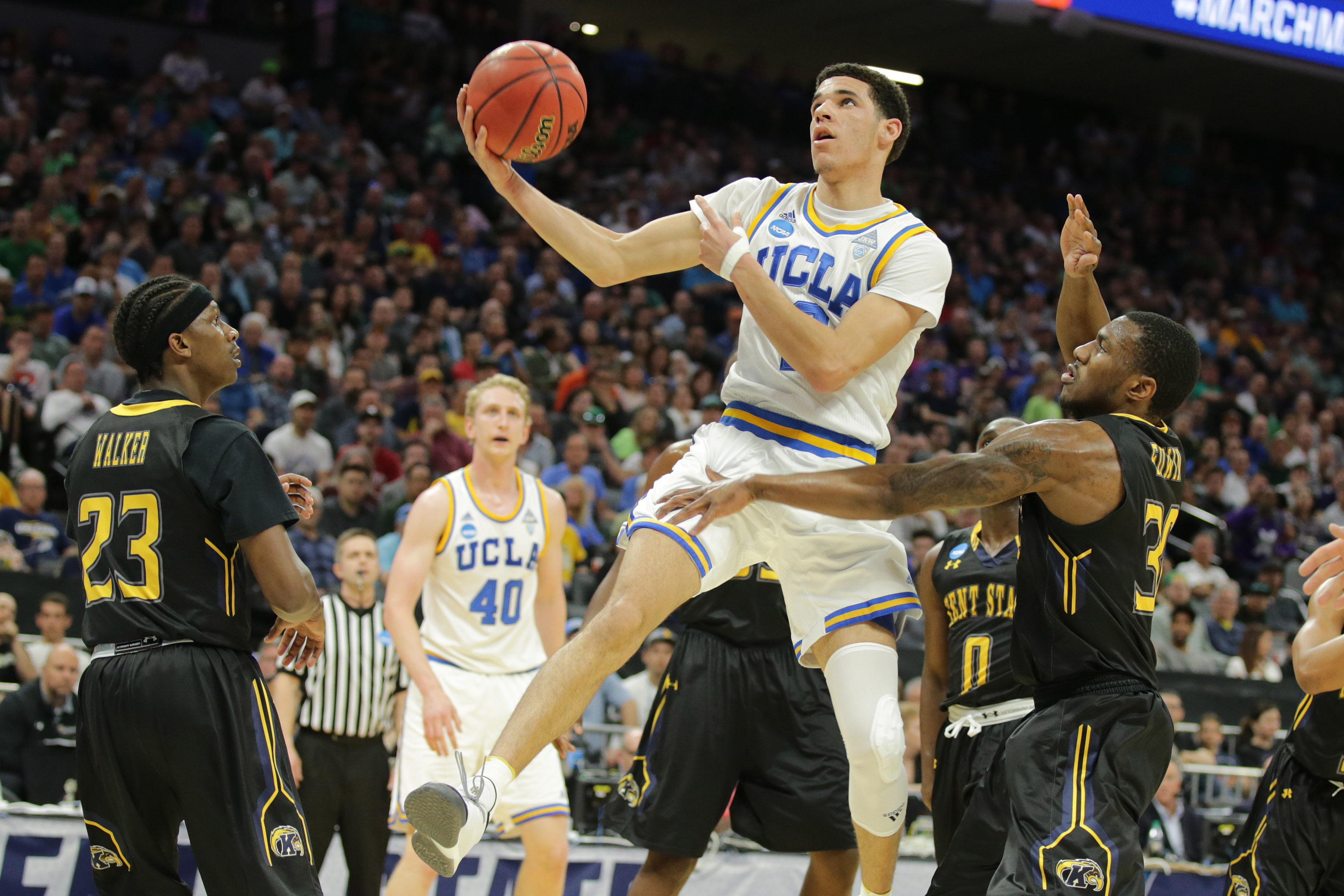 9951734-ncaa-basketball-ncaa-tournament-first-round-kent-state-and-ucla-bruins-1