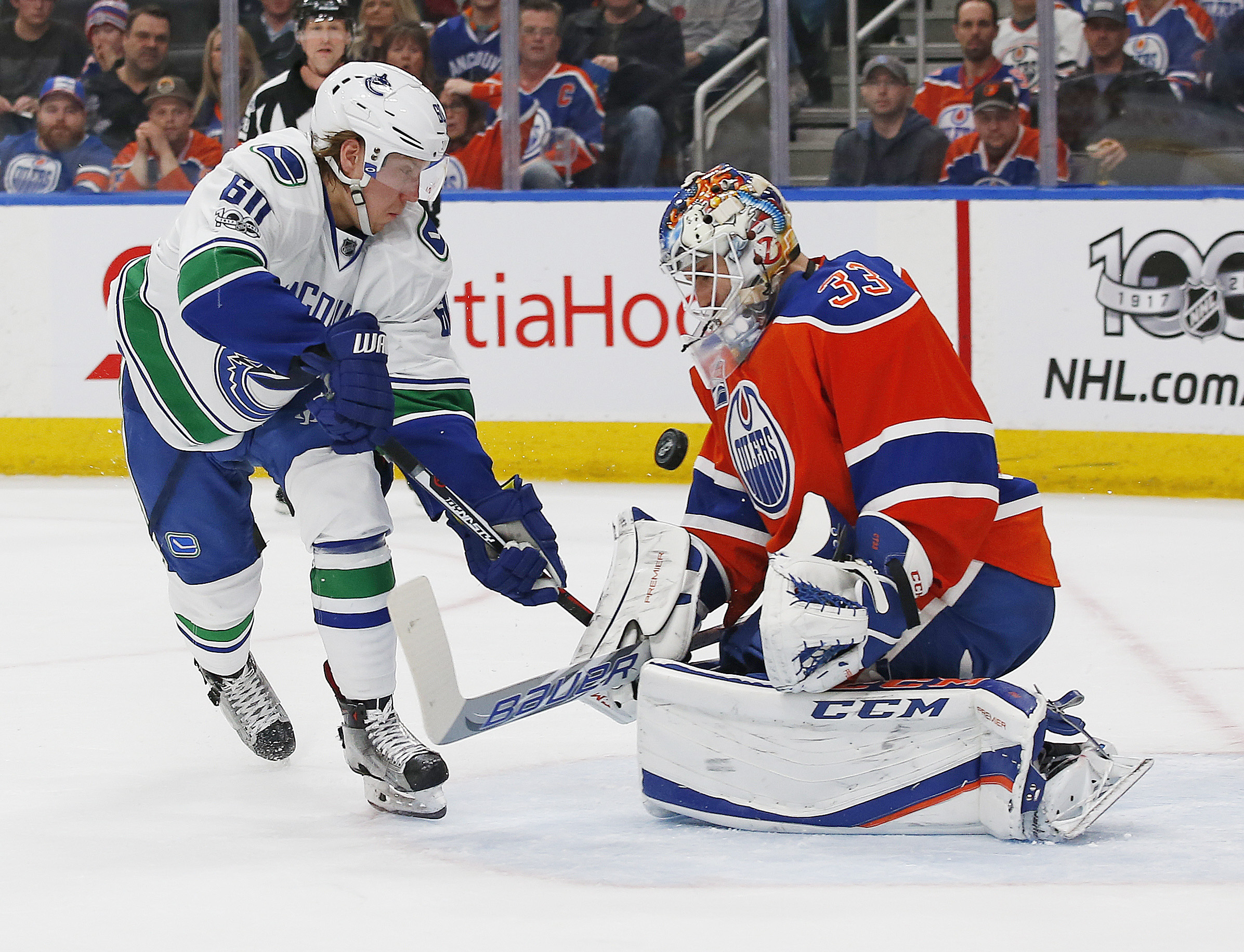 9955307-nhl-vancouver-canucks-at-edmonton-oilers