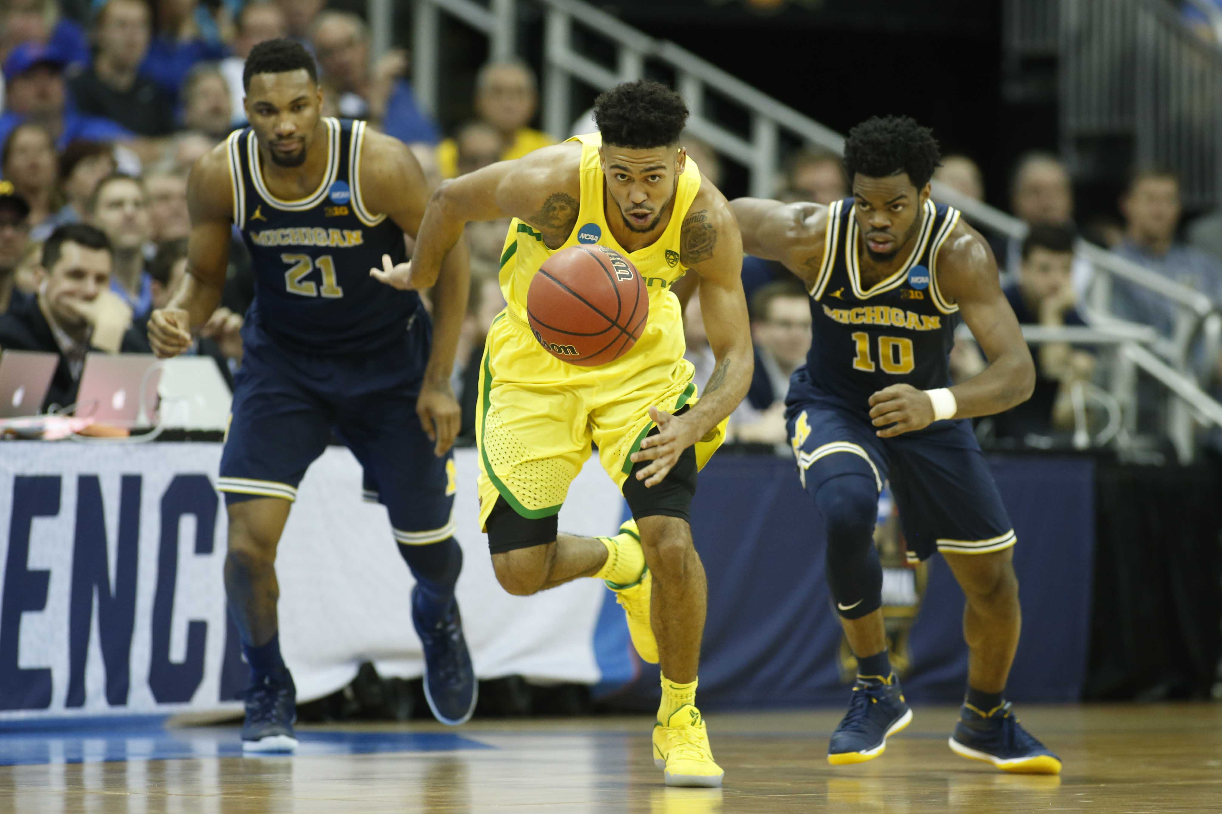 9966594-ncaa-basketball-ncaa-tournament-midwest-regional-oregon-vs-michigan