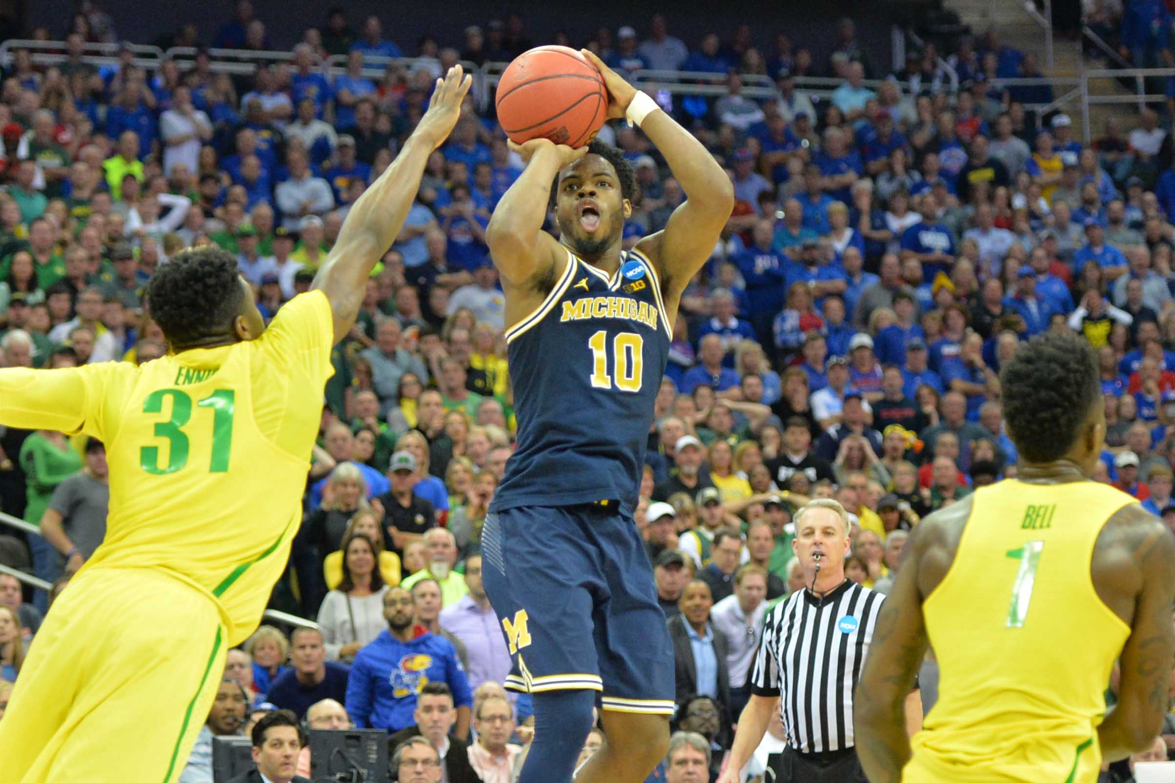 9966680-ncaa-basketball-ncaa-tournament-midwest-regional-oregon-vs-michigan-1