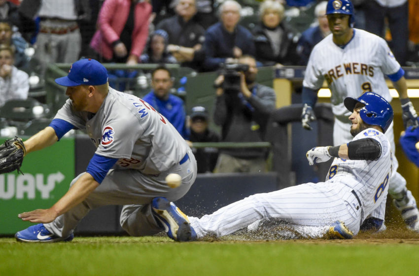 Apr 7, 2017; Milwaukee, WI, USA; Milwaukee Brewers left fielder Ryan Braun (8) scores the winning run on a wild pitch as Chicago Cubs pitcher Mike Montgomery (38) drops the ball in the eleventh inning at Miller Park. The Brewers beat the Cubs 2-1 in 11 innings. Mandatory Credit: Benny Sieu-USA TODAY Sports