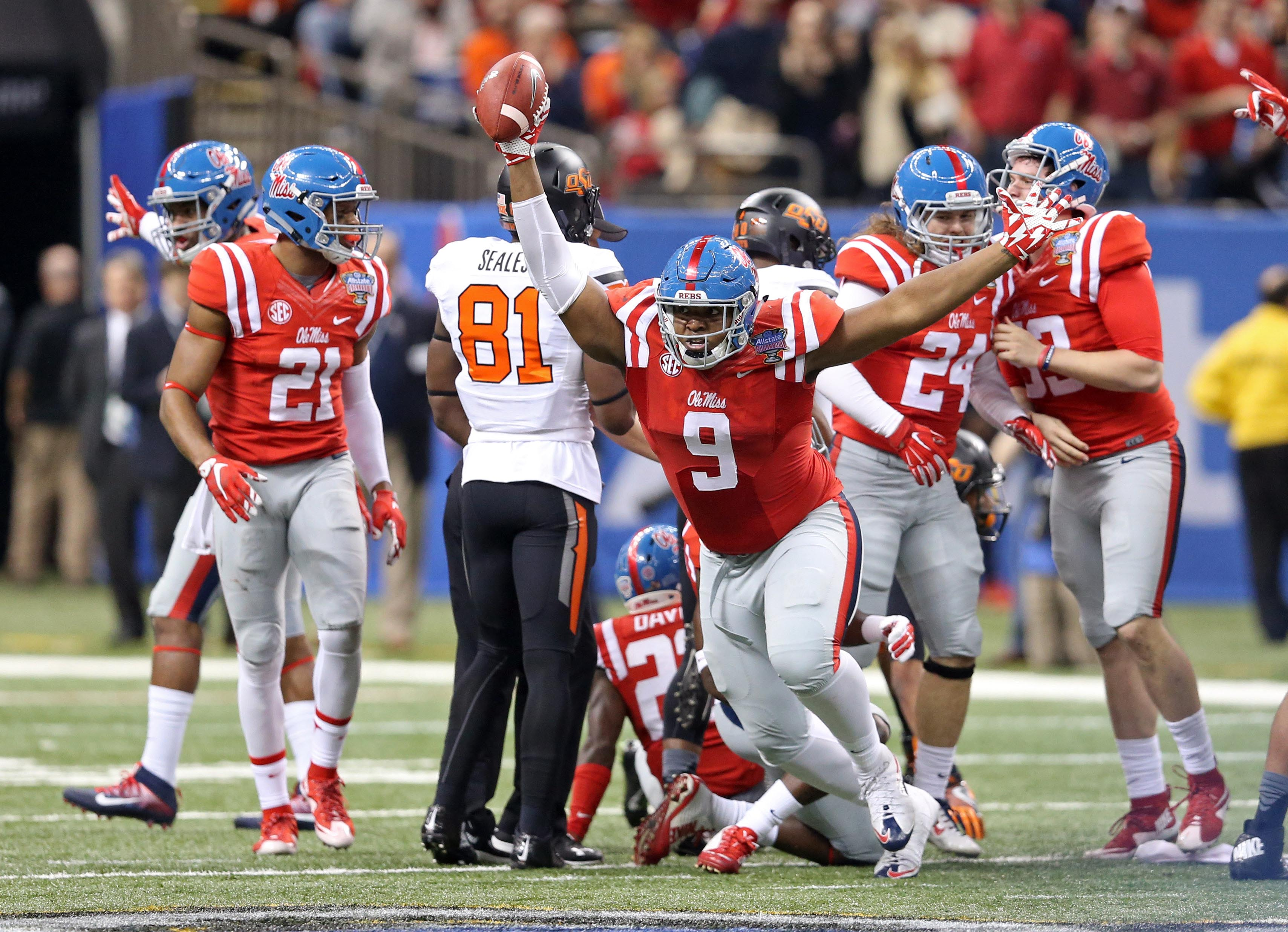 Jan 1, 2016; New Orleans, LA, USA; Mississippi Rebels defensive tackle Breeland Speaks (9) celebrates his fumble recovery in the third quarter against the Oklahoma State Cowboys in the 2016 Sugar Bowl at the Mercedes-Benz Superdome. Mandatory Credit: Chuck Cook-USA TODAY Sports