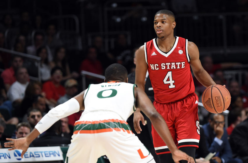 Dec 31, 2016; Coral Gables, FL, USA; North Carolina State Wolfpack guard Dennis Smith Jr. (4) dribbles the ball against Miami Hurricanes guard Ja'Quan Newton (0) during the first half at Watsco Center. Mandatory Credit: Steve Mitchell-USA TODAY Sports