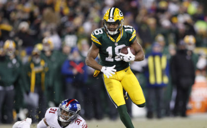 Jan 8, 2017; Green Bay, WI, USA; Green Bay Packers wide receiver Randall Cobb (18) runs past New York Giants cornerback Trevin Wade (31) to score a touchdown during the third quarter in the NFC Wild Card playoff football game at Lambeau Field. Jeff Hanisch-USA TODAY Sports