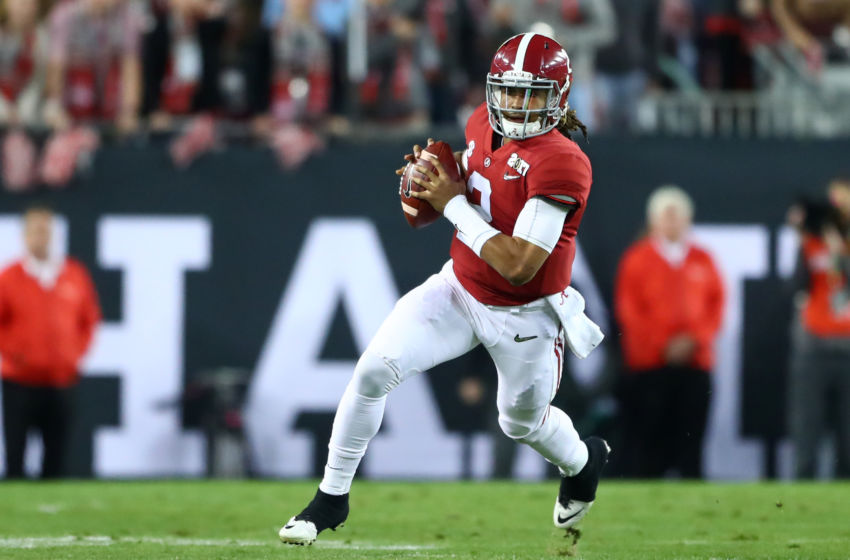 Jan 9, 2017; Tampa, FL, USA; Alabama Crimson Tide quarterback Jalen Hurts (2) runs the ball during the first quarter against the Clemson Tigers in the 2017 College Football Playoff National Championship Game at Raymond James Stadium. Mandatory Credit: Mark J. Rebilas-USA TODAY Sports
