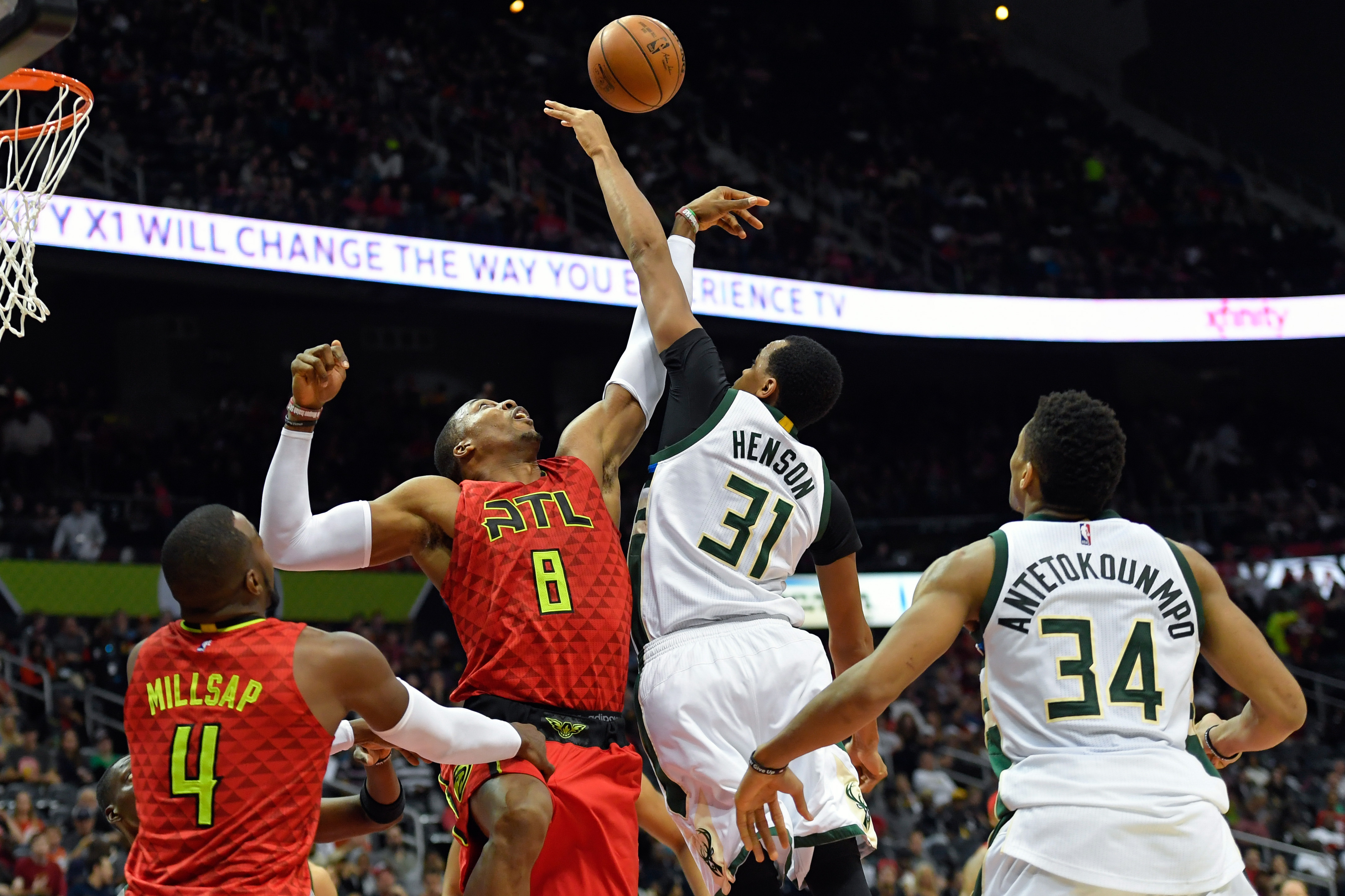 Jan 15, 2017; Atlanta, GA, USA; Atlanta Hawks center Dwight Howard (8) and Milwaukee Bucks center John Henson (31) fight for a rebound during the second half at Philips Arena. The Hawks defeated the Bucks 111-98.Mandatory Credit: Dale Zanine-USA TODAY Sports