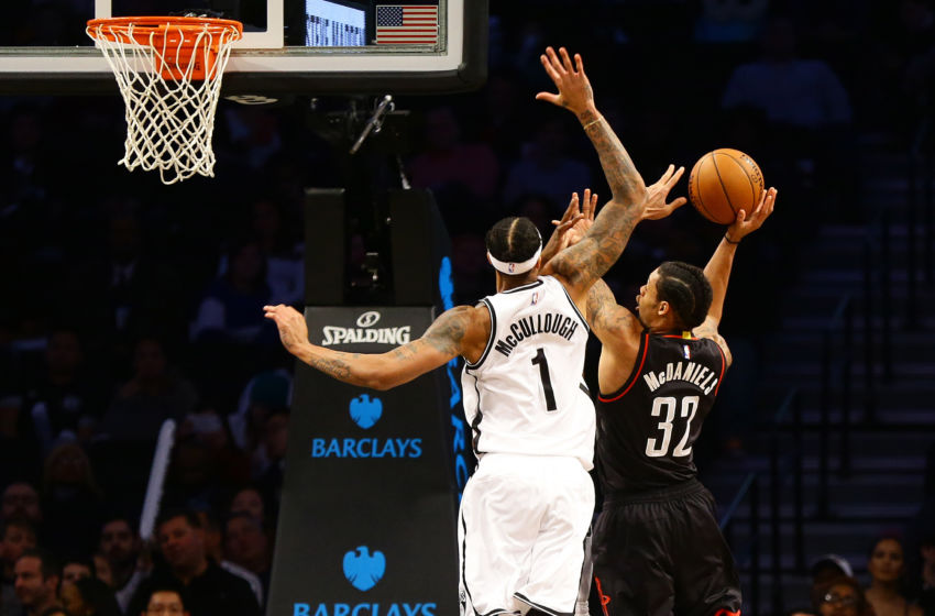 Jan 15, 2017; Brooklyn, NY, USA; Houston Rockets forward K.J.McDaniels (32) shoots the ball against Brooklyn Nets forward Chris McCullough (1) during the second half at Barclays Center. The Rockets won 137-112. Mandatory Credit: Andy Marlin-USA TODAY Sports