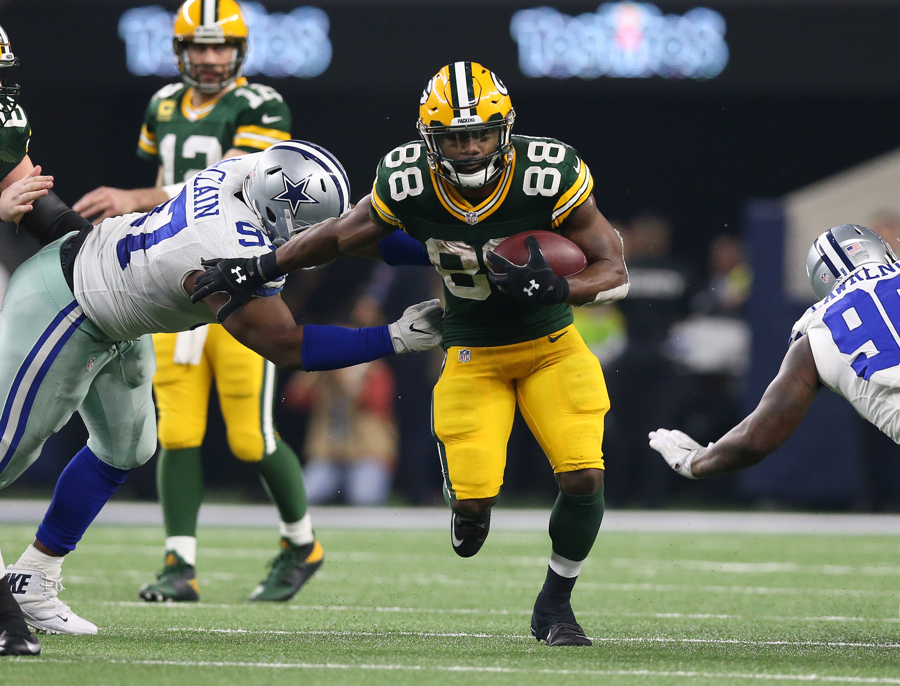 Green Bay Packers running back Ty Montgomery stiff arms against Dallas Cowboys defensive tackle Terrell McClain in the NFC Divisional playoff game at AT&T Stadium. Matthew Emmons-USA TODAY Sports