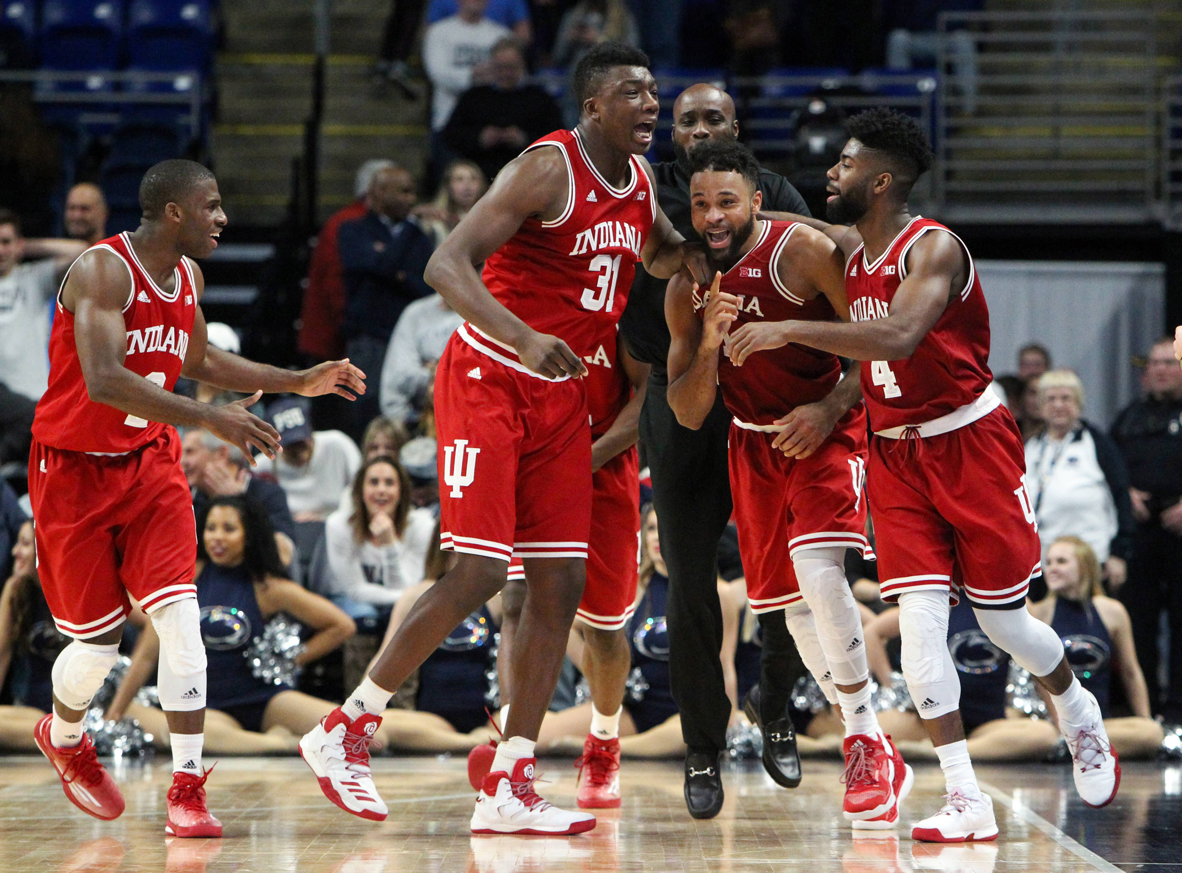 Jan 18, 2017; University Park, PA, USA; Indiana Hoosiers guard James Blackmon Jr (second from right) celebrates with teammates after scoring the winning shot during the second half against the Penn State Nittany Lions at Bryce Jordan Center. Indiana defeated Penn State 78-75. Mandatory Credit: Matthew O'Haren-USA TODAY Sports