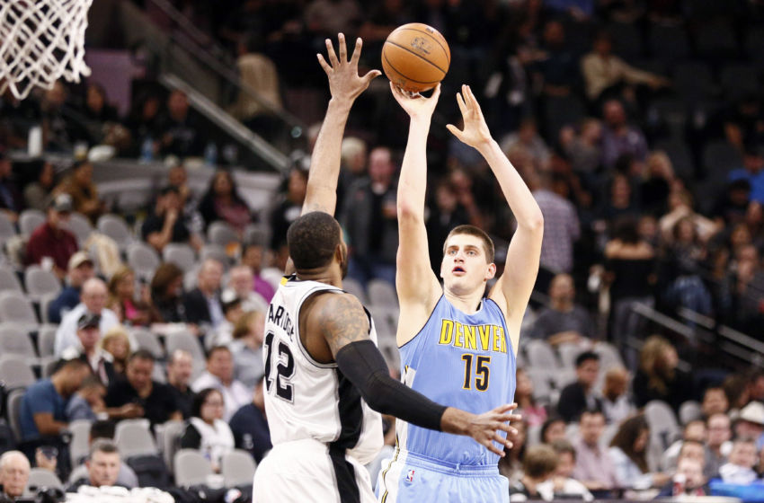 Jan 19, 2017; San Antonio, TX, USA; Denver Nuggets power forward Nikola Jokic (15) shoots the ball over San Antonio Spurs power forward LaMarcus Aldridge (12) during the second half at AT&T Center. Mandatory Credit: Soobum Im-USA TODAY Sports