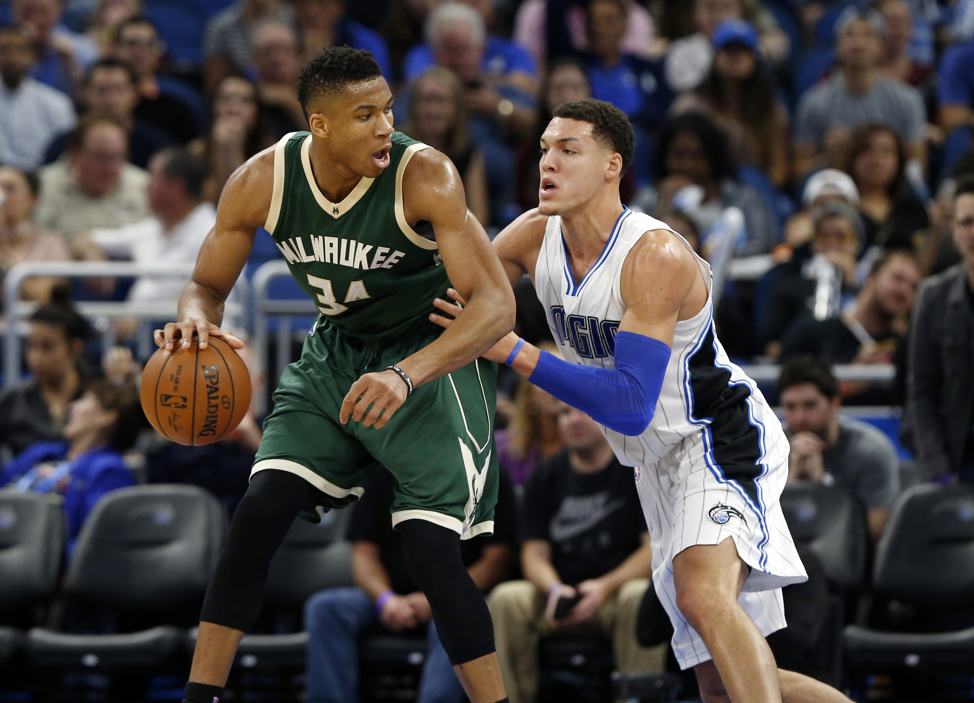 Jan 20, 2017; Orlando, FL, USA;Milwaukee Bucks forward Giannis Antetokounmpo (34) drives to the basket as Orlando Magic forward Aaron Gordon (00) defends during the second half at Amway Center. Orlando Magic defeated the Milwaukee Bucks 112-96. Mandatory Credit: Kim Klement-USA TODAY Sports
