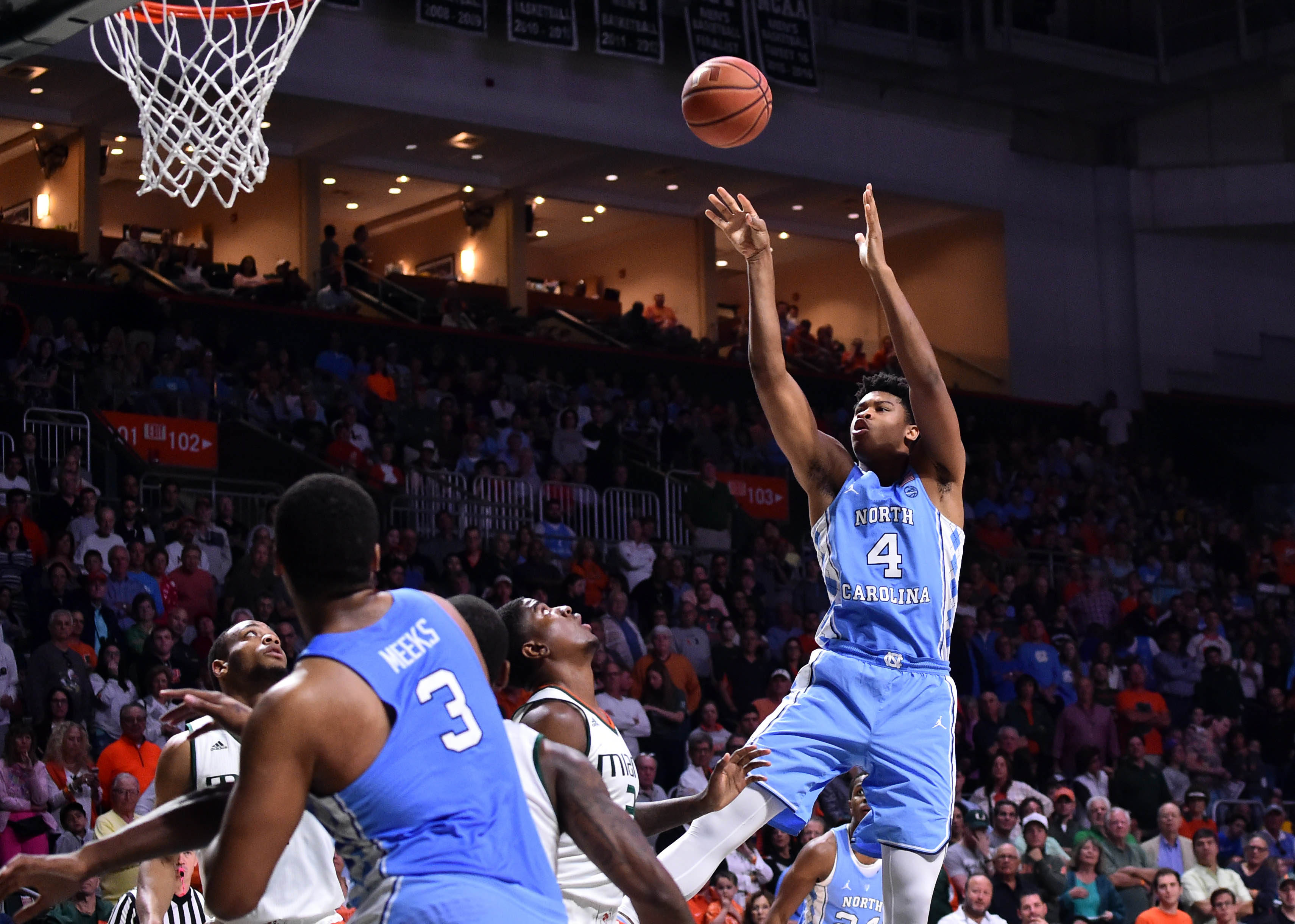 Jan 28, 2017; Coral Gables, FL, USA; North Carolina Tar Heels forward Kennedy Meeks (3) shoots over Miami Hurricanes forward Anthony Lawrence Jr. (3) during the first half at Watsco Center. Mandatory Credit: Steve Mitchell-USA TODAY Sports
