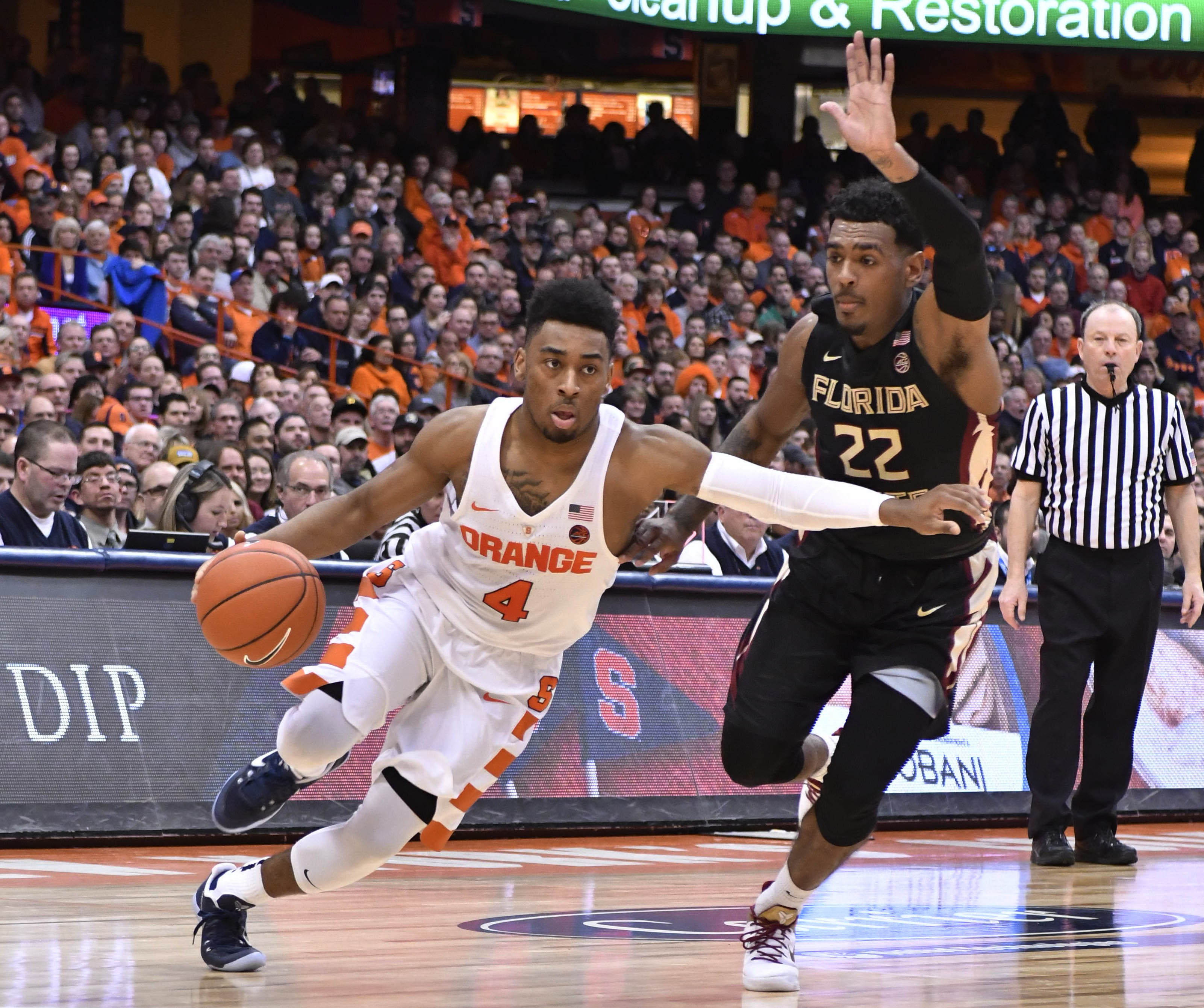 Jan 28, 2017; Syracuse, NY, USA; Syracuse Orange guard John Gillon (4) drives the ball past Florida State Seminoles guard Xavier Rathan-Mayes (22) during the second half of a game at the Carrier Dome. Syracuse won the contest 82-72. Mandatory Credit: Mark Konezny-USA TODAY Sports