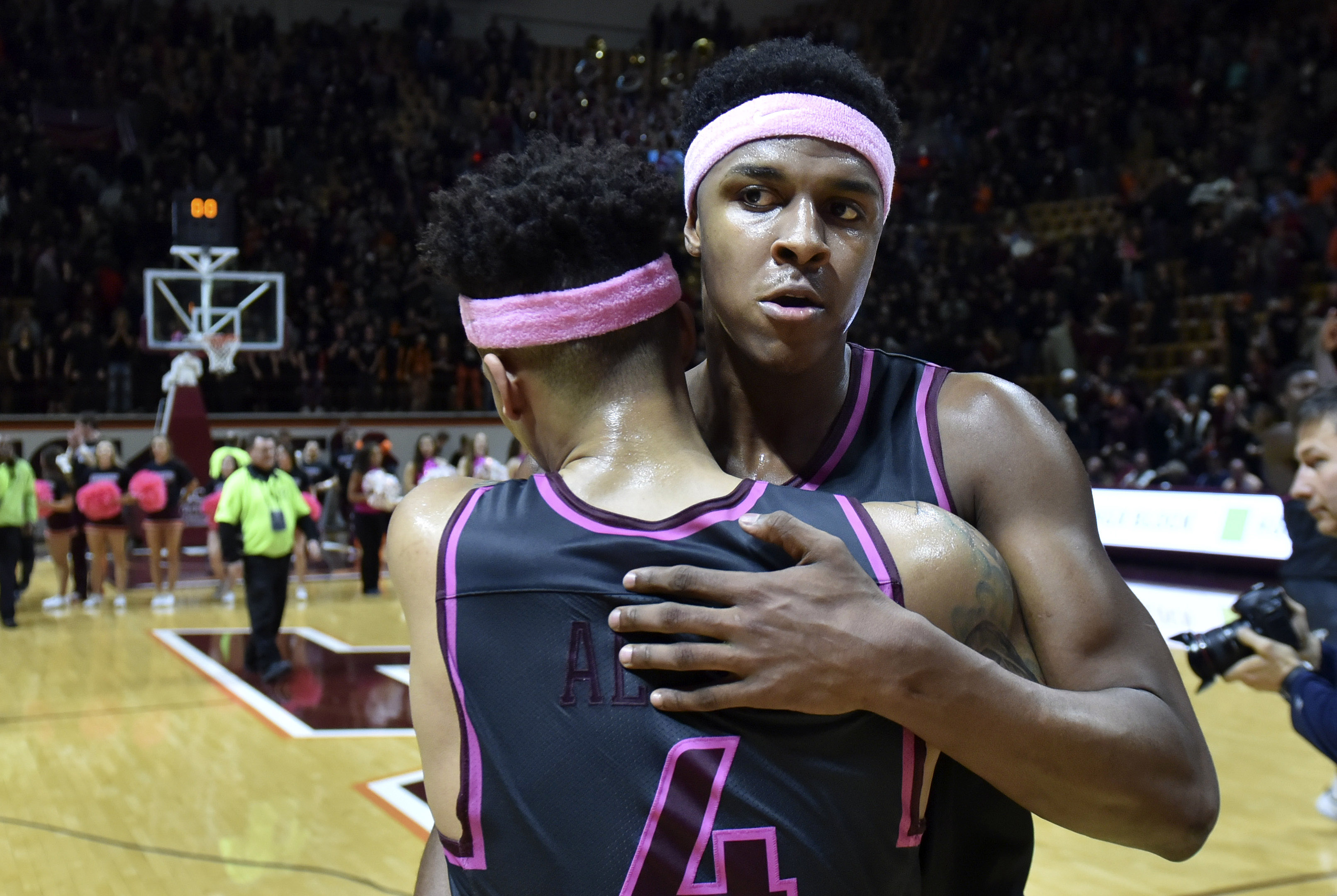 Jan 29, 2017; Blacksburg, VA, USA; Virginia Tech Hokies guard Seth Allen (4) is hugged by forward Zach LeDay (32) following the victory against the Boston College Eagles at Cassell Coliseum. Mandatory Credit: Michael Shroyer-USA TODAY Sports