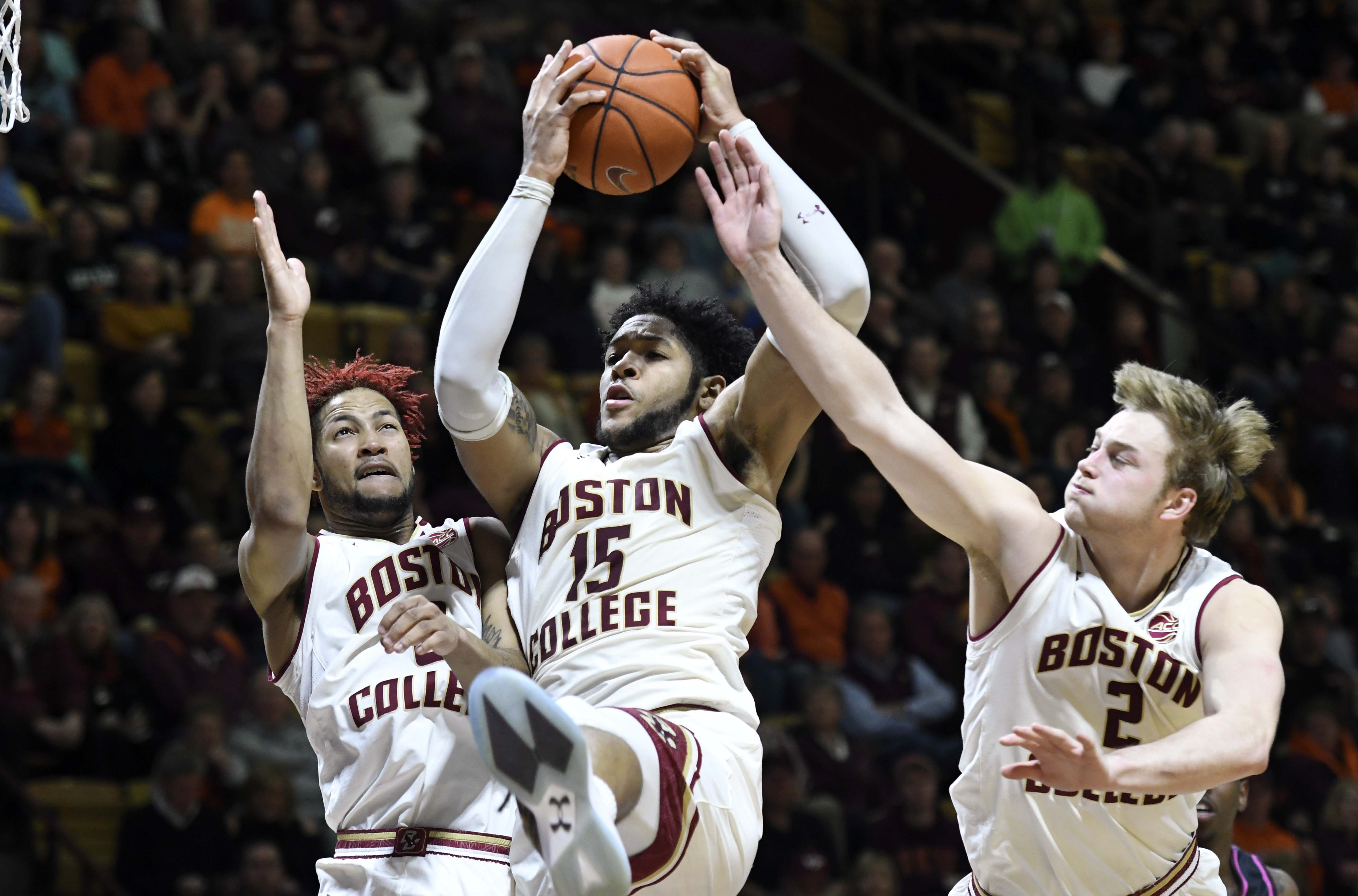 Jan 29, 2017; Blacksburg, VA, USA; Boston College Eagles forward Mo Jeffers (15) beats teammates guard Ky Bowman (0) and forward Connar Tava (2) to the rebound in the second half against the Virginia Tech Hokies at Cassell Coliseum. Mandatory Credit: Michael Shroyer-USA TODAY Sports