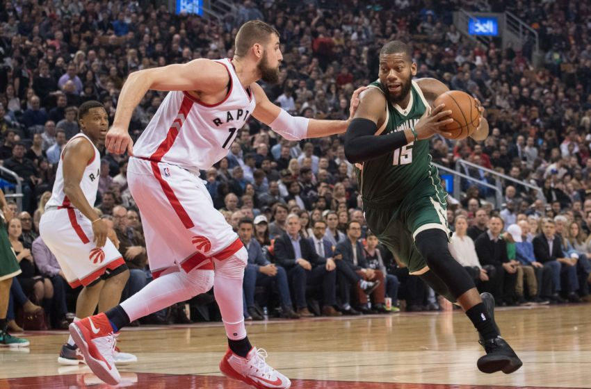 Jan 27, 2017; Toronto, Ontario, CAN; Milwaukee Bucks center Greg Monroe (15) drives to the basket as Toronto Raptors center Jonas Valanciunas (17) defends during the first quarter in a game at Air Canada Centre. The Toronto Raptors won 102-86. Mandatory Credit: Nick Turchiaro-USA TODAY Sports