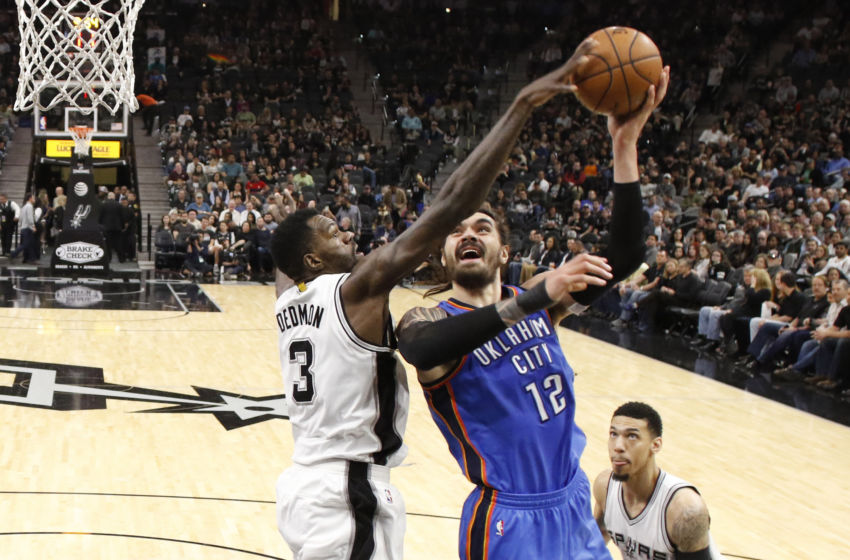 Jan 31, 2017; San Antonio, TX, USA; Oklahoma City Thunder center Steven Adams (12) shoots the ball as San Antonio Spurs center Dewayne Dedmon (3) defends during the second half at AT&T Center. The Spurs won 108-94. Mandatory Credit: Soobum Im-USA TODAY Sports