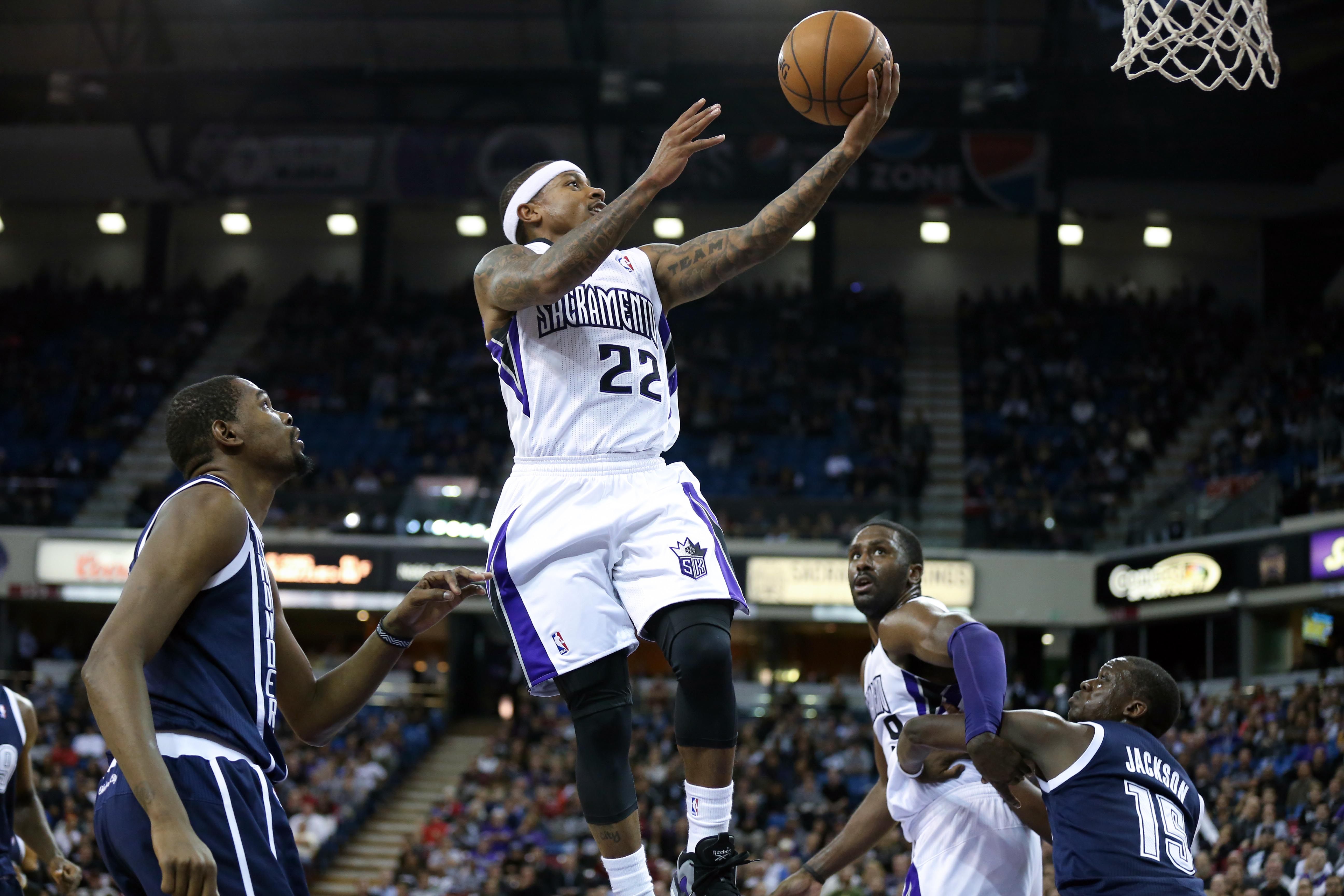 Dec 3, 2013; Sacramento, CA, USA; Sacramento Kings point guard Isaiah Thomas (22) goes up for a basket above Oklahoma City Thunder small forward Kevin Durant (35) during the fourth quarter at Sleep Train Arena. The Oklahoma City Thunder defeated the Sacramento Kings 97-95. Mandatory Credit: Kelley L Cox-USA TODAY Sports