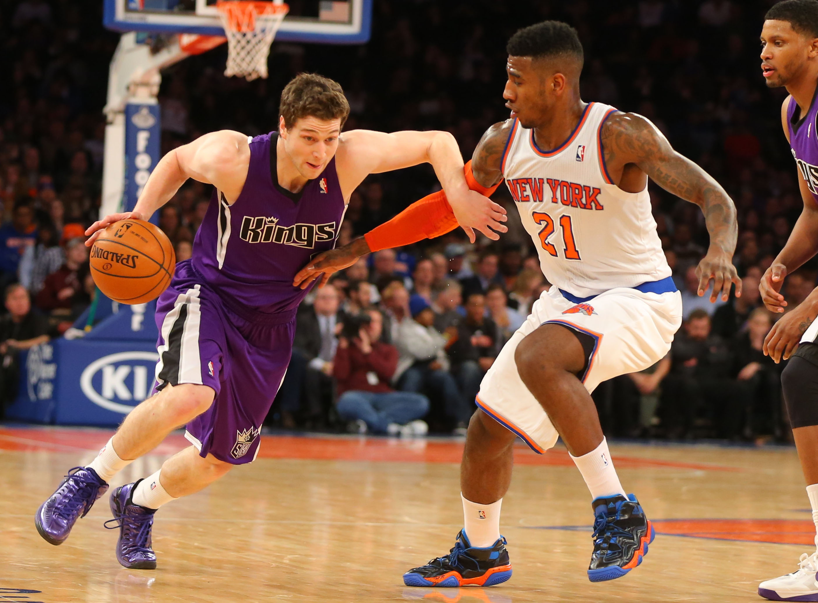 Feb 12, 2014; New York, NY, USA; Sacramento Kings point guard Jimmer Fredette (7) drives to the basket against New York Knicks shooting guard Iman Shumpert (21) at Madison Square Garden. Mandatory Credit: Jim O'Connor-USA TODAY Sports