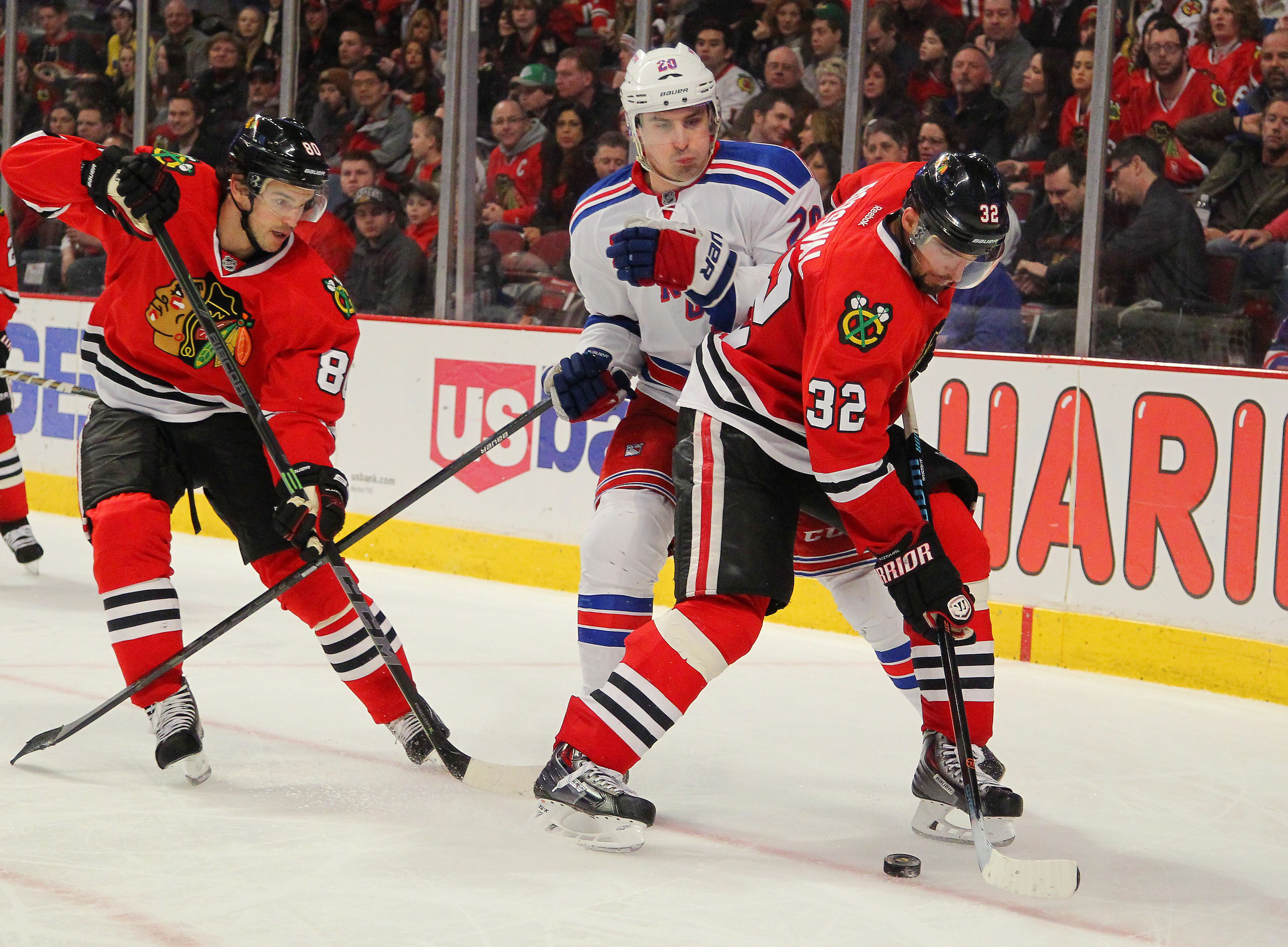 Mar 8, 2015; Chicago, IL, USA; Chicago Blackhawks defenseman Michal Rozsival (32) is pursued by New York Rangers left wing Chris Kreider (20) during the third period at the United Center. New York won 1-0 in overtime. Mandatory Credit: Dennis Wierzbicki-USA TODAY Sports