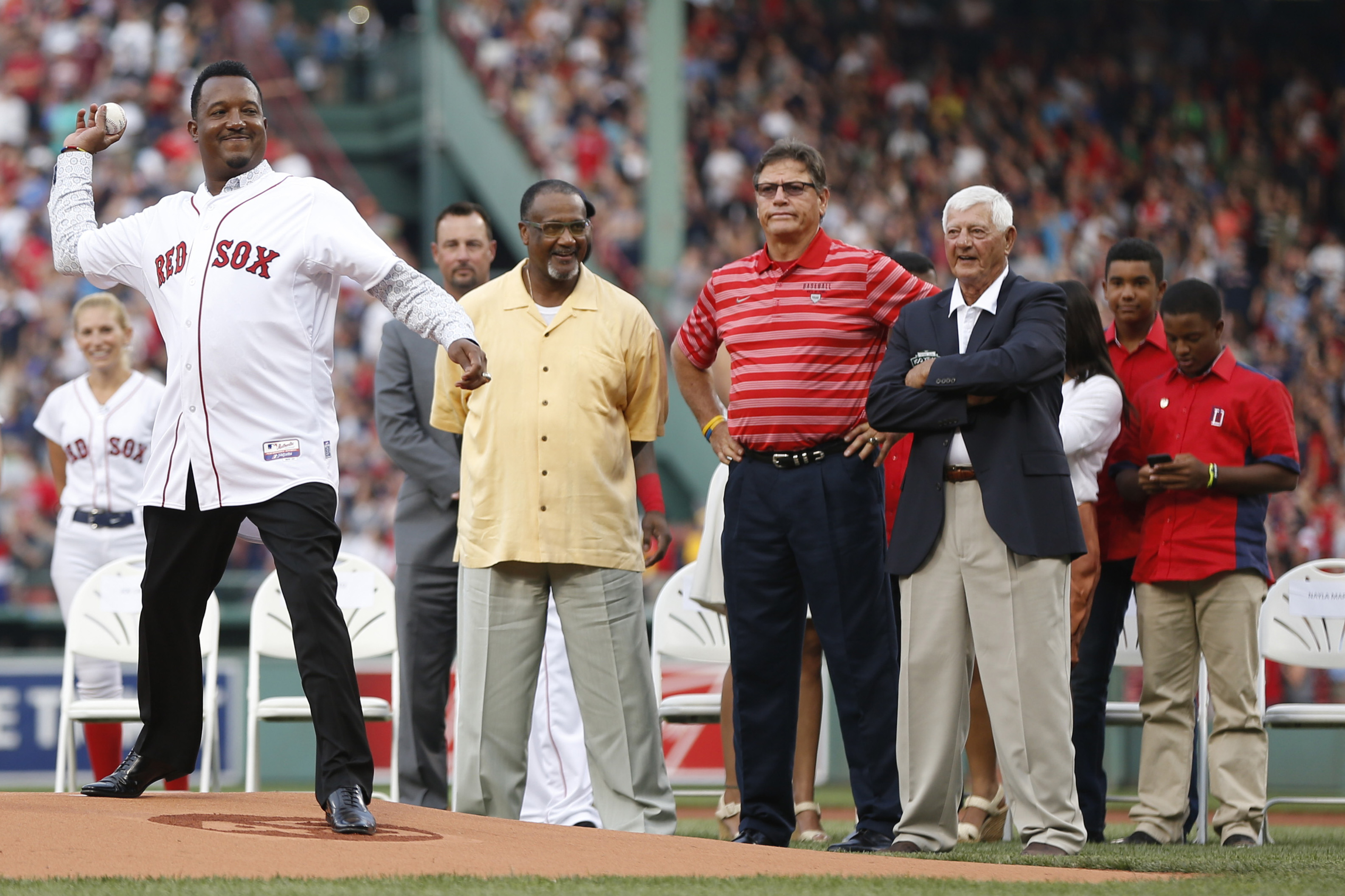 Jul 28, 2015; Boston, MA, USA; Hall of Fame player Pedro Martinez throws out the first pitch under the watchful eye of former Boston Red Sox players Tim Wakefield, (left) Jim Rice, Carlton Fisk and Carl Yastrzemsk during his number retirement ceremony before the game against the Chicago White Sox at Fenway Park. Mandatory Credit: Greg M. Cooper-USA TODAY Sports