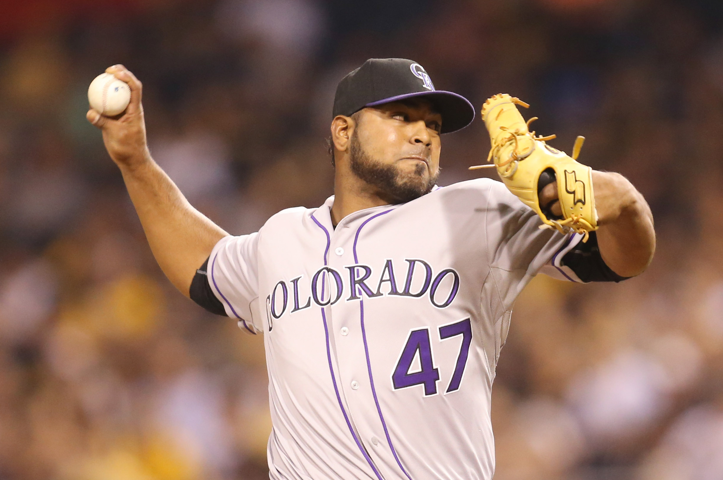 Aug 28, 2015; Pittsburgh, PA, USA; Colorado Rockies relief pitcher Jairo Diaz (47) pitches against the Pittsburgh Pirates during the seventh inning at PNC Park. The Pirates won 5-3. Mandatory Credit: Charles LeClaire-USA TODAY Sports
