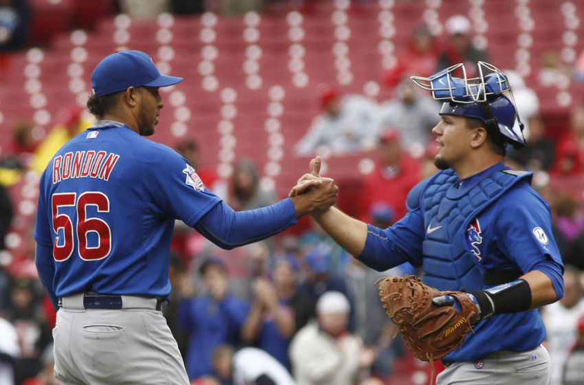 Oct 1, 2015; Cincinnati, OH, USA; Chicago Cubs relief pitcher Hector Rondon (56) is congratulated by catcher Kyle Schwarber (right) after defeating the Reds 5-3 at Great American Ball Park. Mandatory Credit: David Kohl-USA TODAY Sports