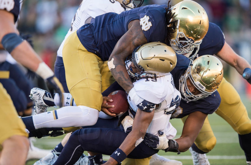 Oct 10, 2015; South Bend, IN, USA; Navy Midshipmen quarterback Keenan Reynolds (19) is tackled by Notre Dame Fighting Irish linebacker Jaylon Smith (9) in the third quarter at Notre Dame Stadium. Mandatory Credit: Matt Cashore-USA TODAY Sports