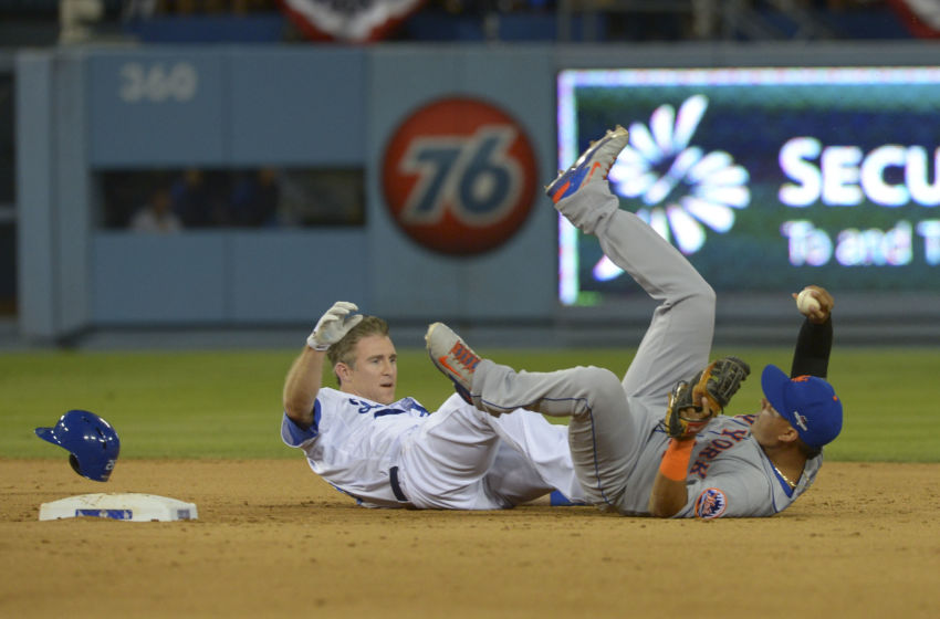 Oct 10, 2015; Los Angeles, CA, USA; New York Mets shortstop Ruben Tejada (right) collides with Los Angeles Dodgers second baseman Chase Utley (left) at second base during the seventh inning in game two of the NLDS at Dodger Stadium. Mandatory Credit: Jayne Kamin-Oncea-USA TODAY Sports