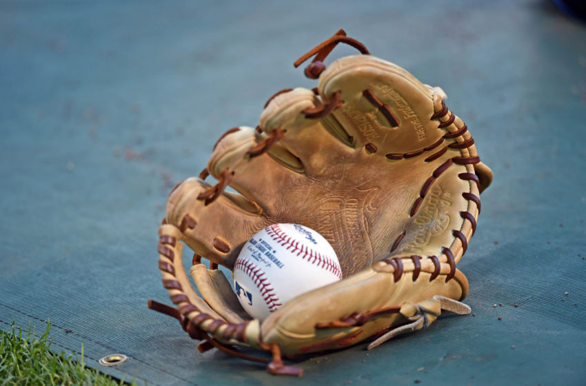 Oct 16, 2015; Kansas City, MO, USA; A general view of a glove and baseball during batting practice prior to game one of the ALCS between the Kansas City Royals and the Toronto Blue Jays at Kauffman Stadium. Mandatory Credit: Peter G. Aiken-USA TODAY Sports