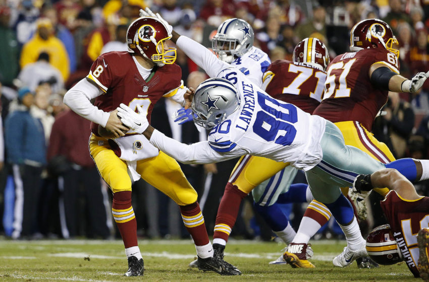 Dec 7, 2015; Landover, MD, USA; Dallas Cowboys defensive end Demarcus Lawrence (90) knocks the ball out of the hands of Washington Redskins quarterback Kirk Cousins (8) in the first quarter at FedEx Field. Mandatory Credit: Geoff Burke-USA TODAY Sports