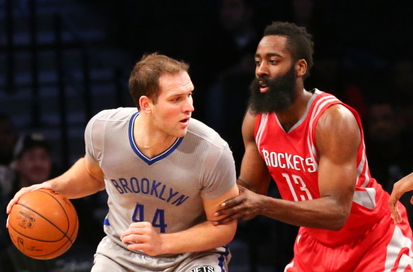 Dec 8, 2015; Brooklyn, NY, USA; Houston Rockets guard James Harden (13) defends Brooklyn Nets guard Bojan Bogdanovic (44) during the first quarter at Barclays Center. Mandatory Credit: Anthony Gruppuso-USA TODAY Sports
