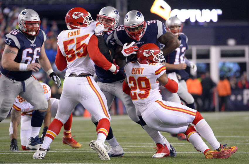 Jan 16, 2016; Foxborough, MA, USA; New England Patriots running back Steven Jackson (39) runs the ball against Kansas City Chiefs free safety Eric Berry (29) during the third quarter in the AFC Divisional round playoff game at Gillette Stadium. Mandatory Credit: Robert Deutsch-USA TODAY Sports