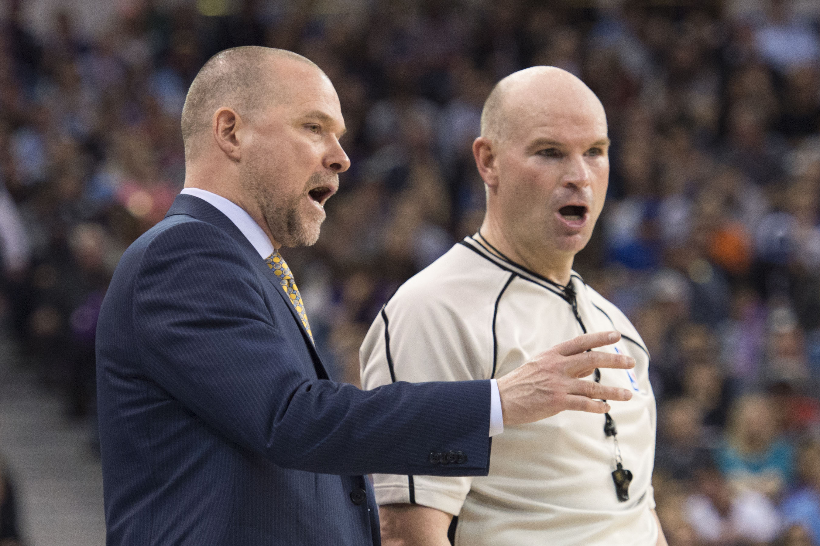 February 19, 2016; Sacramento, CA, USA; Denver Nuggets head coach Michael Malone (left) argues with NBA referee Gary Zielinski (59) during the fourth quarter against the Sacramento Kings at Sleep Train Arena. The Kings defeated the Nuggets 116-110. Mandatory Credit: Kyle Terada-USA TODAY Sports