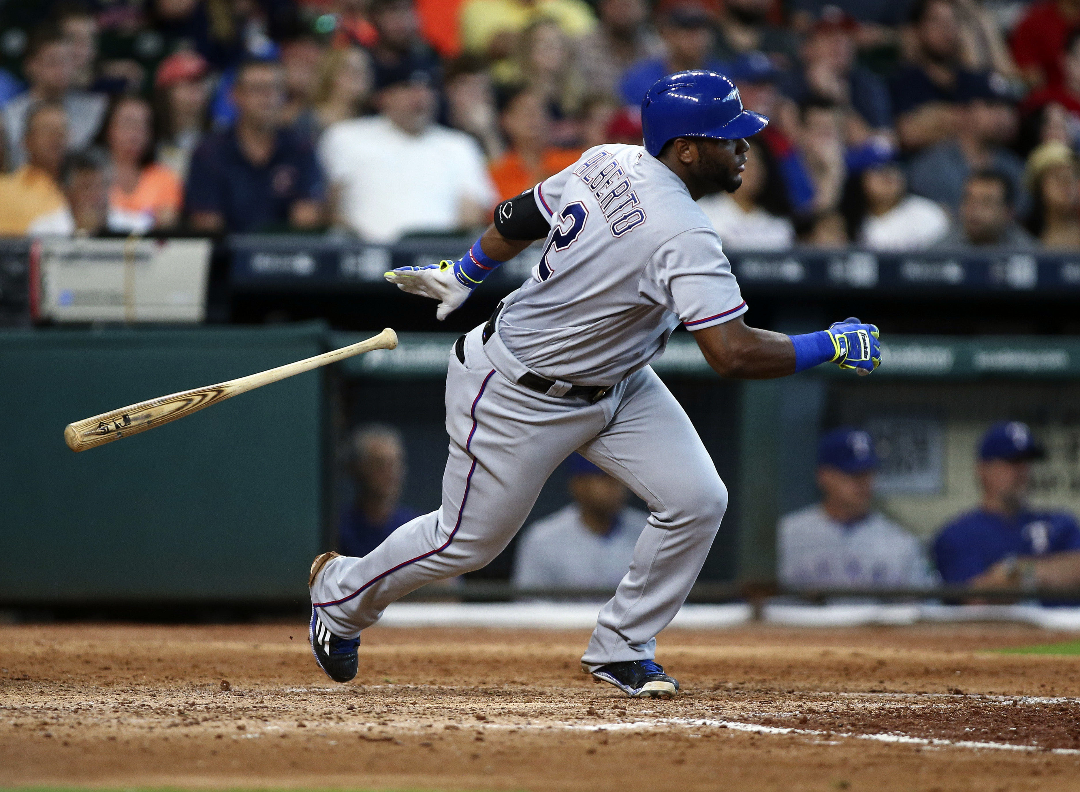 May 22, 2016; Houston, TX, USA; Texas Rangers second baseman Hanser Alberto (2) drives in a run with a single during the sixth inning against the Houston Astros at Minute Maid Park. Mandatory Credit: Troy Taormina-USA TODAY Sports