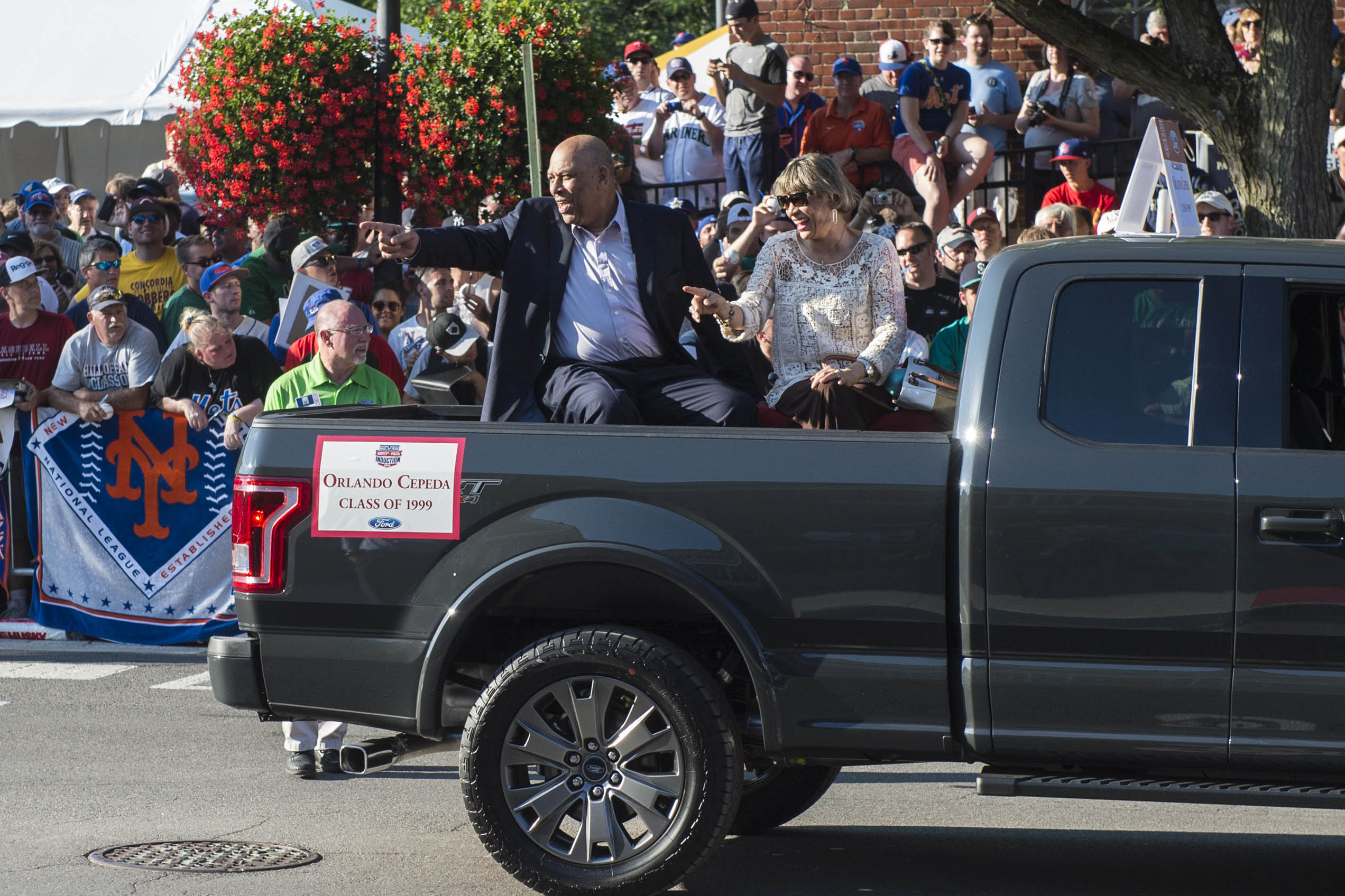 Jul 23, 2016; Cooperstown, NY, USA; Hall of Famer Orlando Cepeda and his wife during the MLB baseball hall of fame parade of legends at National Baseball Hall of Fame. Mandatory Credit: Gregory J. Fisher-USA TODAY Sports