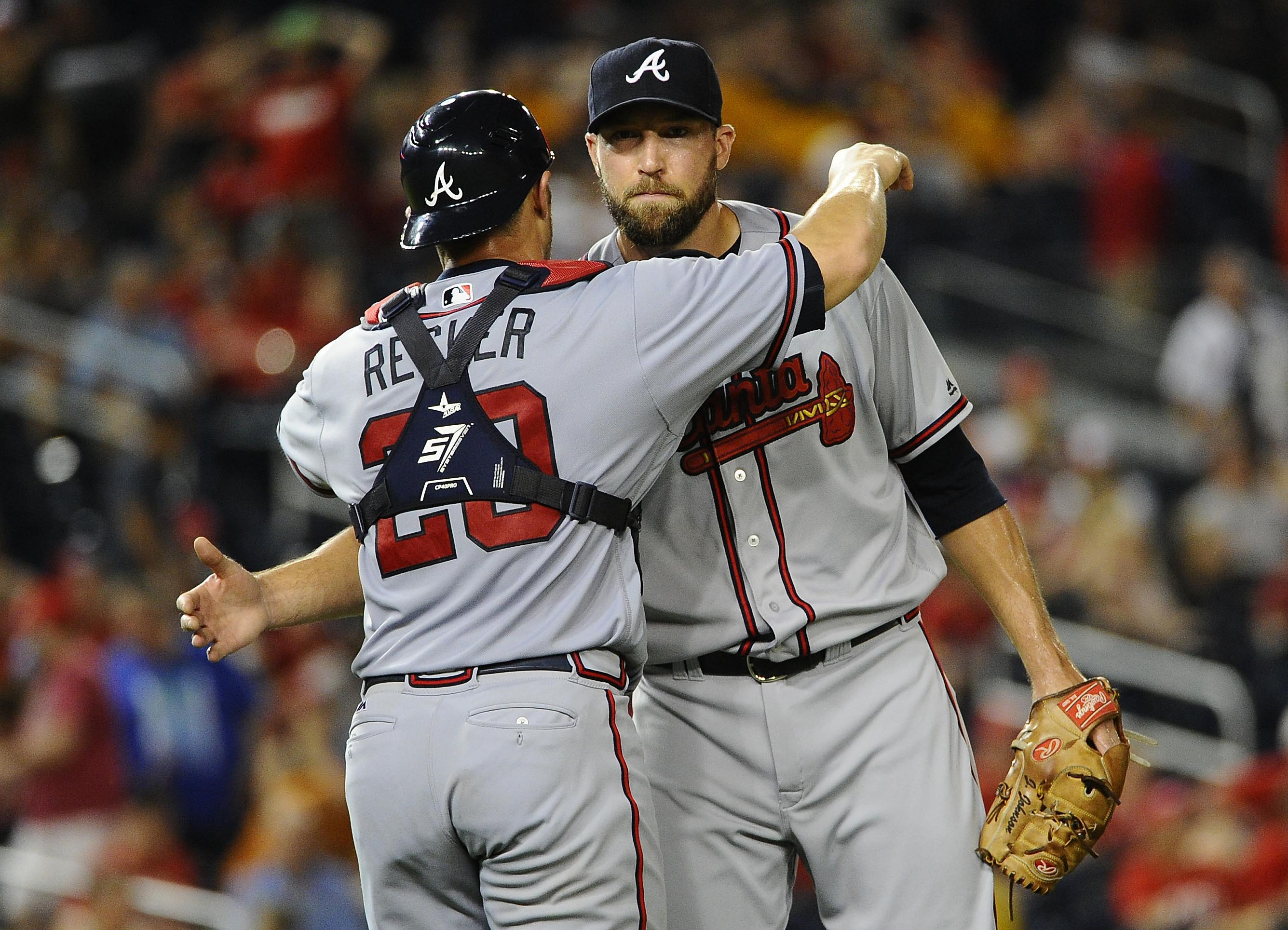 Aug 12, 2016; Washington, DC, USA; Atlanta Braves relief pitcher Jim Johnson (53) is congratulated by catcher Anthony Recker (20) after earning a save against the Washington Nationals at Nationals Park. Mandatory Credit: Brad Mills-USA TODAY Sports