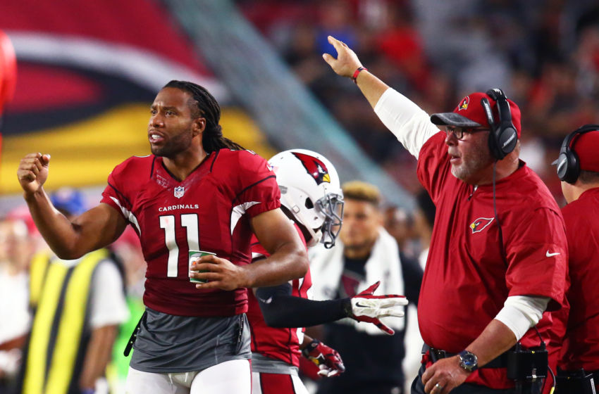 Aug 12, 2016; Glendale, AZ, USA; Arizona Cardinals wide receiver Larry Fitzgerald (11) and head coach Bruce Arians against the Oakland Raiders during a preseason game at University of Phoenix Stadium. Mandatory Credit: Mark J. Rebilas-USA TODAY Sports