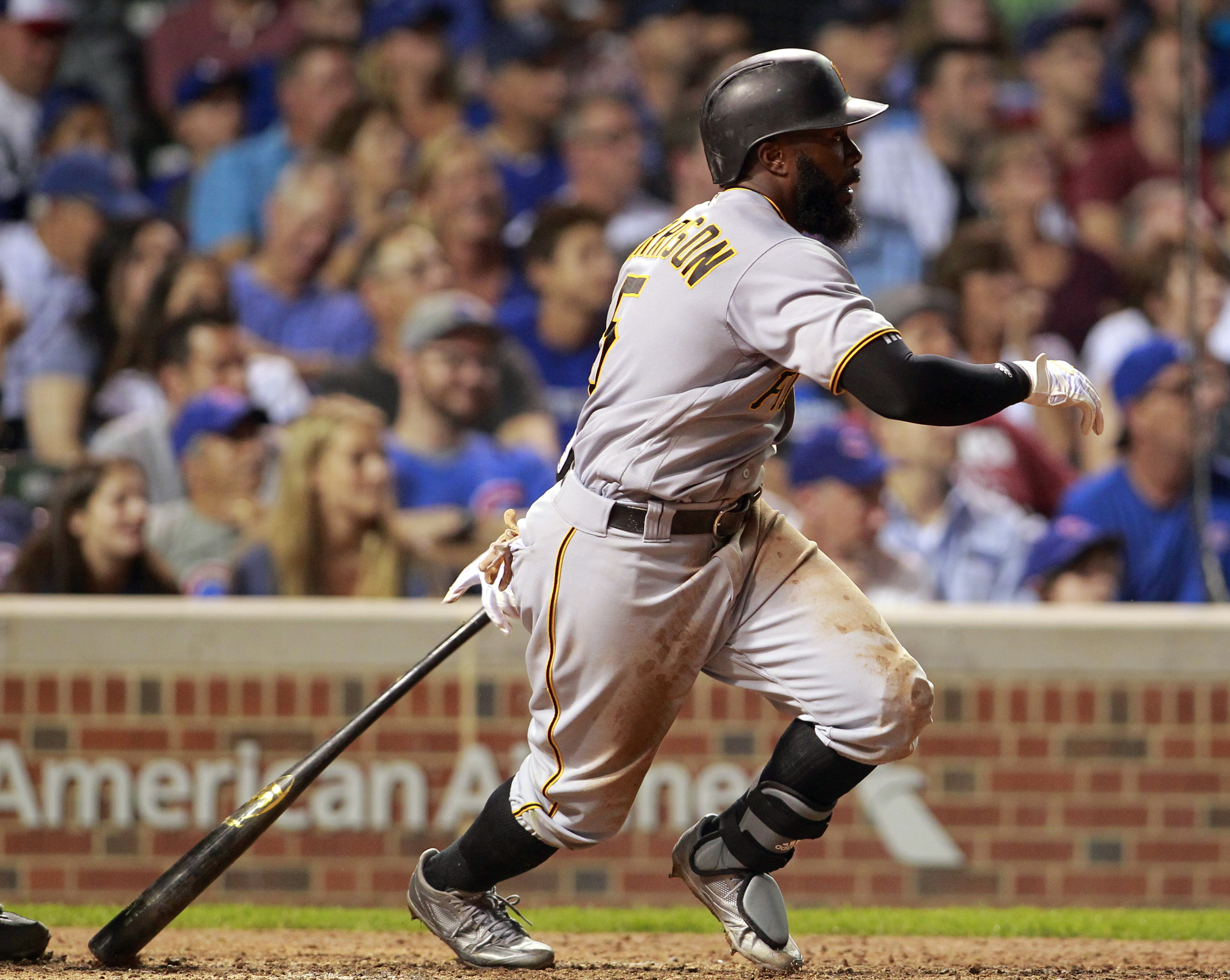 Aug 29, 2016; Chicago, IL, USA; Pittsburgh Pirates second baseman Josh Harrison (5) hits a two run RBI double during the seventh inning against the Chicago Cubs at Wrigley Field. Mandatory Credit: Caylor Arnold-USA TODAY Sports