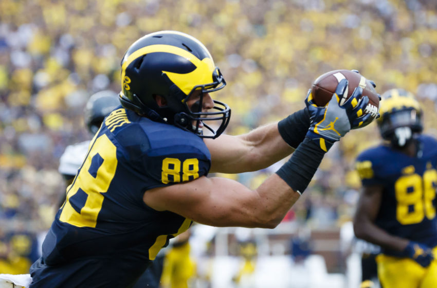 Sep 10, 2016; Ann Arbor, MI, USA; Michigan Wolverines tight end Jake Butt (88) makes a reception for a touchdown in the second quarter against the UCF Knights at Michigan Stadium. Mandatory Credit: Rick Osentoski-USA TODAY Sports