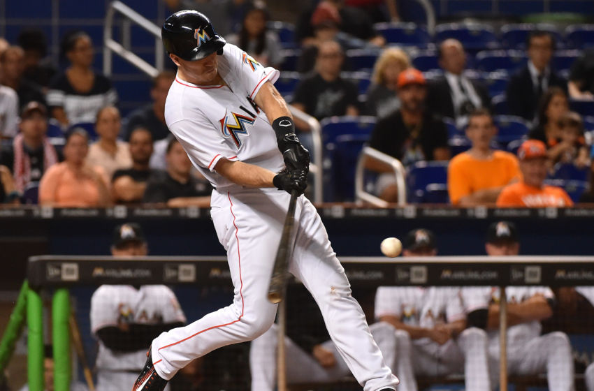 Sep 22, 2016; Miami, FL, USA; Miami Marlins catcher J.T. Realmuto (11) connects for a solo home run in the seventh inning against the Atlanta Braves at Marlins Park. The Atlanta Braves defeat the Miami Marlins 6-3. Mandatory Credit: Jasen Vinlove-USA TODAY Sports
