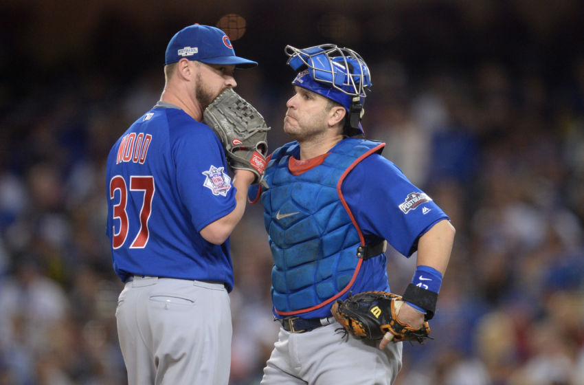 Oct 18, 2016; Los Angeles, CA, USA; Chicago Cubs relief pitcher Travis Wood (37) talks with catcher Miguel Montero (47) during the sixth inning against the Los Angeles Dodgers in game three of the 2016 NLCS playoff baseball series at Dodger Stadium. Mandatory Credit: Gary A. Vasquez-USA TODAY Sports