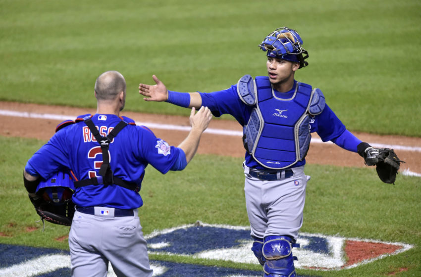 Nov 2, 2016; Cleveland, OH, USA; Chicago Cubs catcher David Ross (3) comes into the game for catcher Willson Contreras (right) in the fifth inning against the Cleveland Indians in game seven of the 2016 World Series at Progressive Field. Mandatory Credit: David Richard-USA TODAY Sports