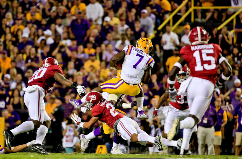 Nov 5, 2016; Baton Rouge, LA, USA; LSU Tigers running back Leonard Fournette (7) leaps over Alabama Crimson Tide defensive back Minkah Fitzpatrick (29) during the second quarter of a game at Tiger Stadium. Mandatory Credit: Derick E. Hingle-USA TODAY Sports
