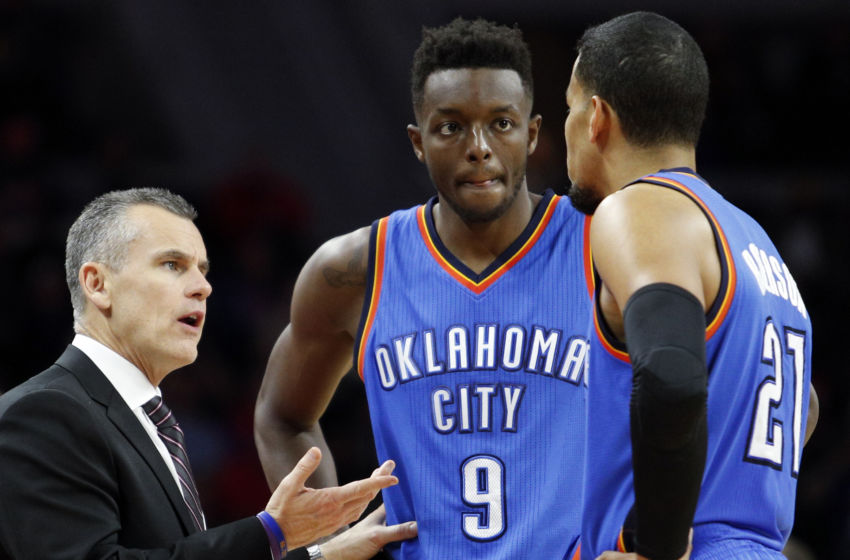 Nov 14, 2016; Auburn Hills, MI, USA; Oklahoma City Thunder head coach Billy Donovan talks with Oklahoma City Thunder forward Jerami Grant (9) and guard Andre Roberson (21) during the second quarter against the Detroit Pistons at The Palace of Auburn Hills. Mandatory Credit: Raj Mehta-USA TODAY Sports
