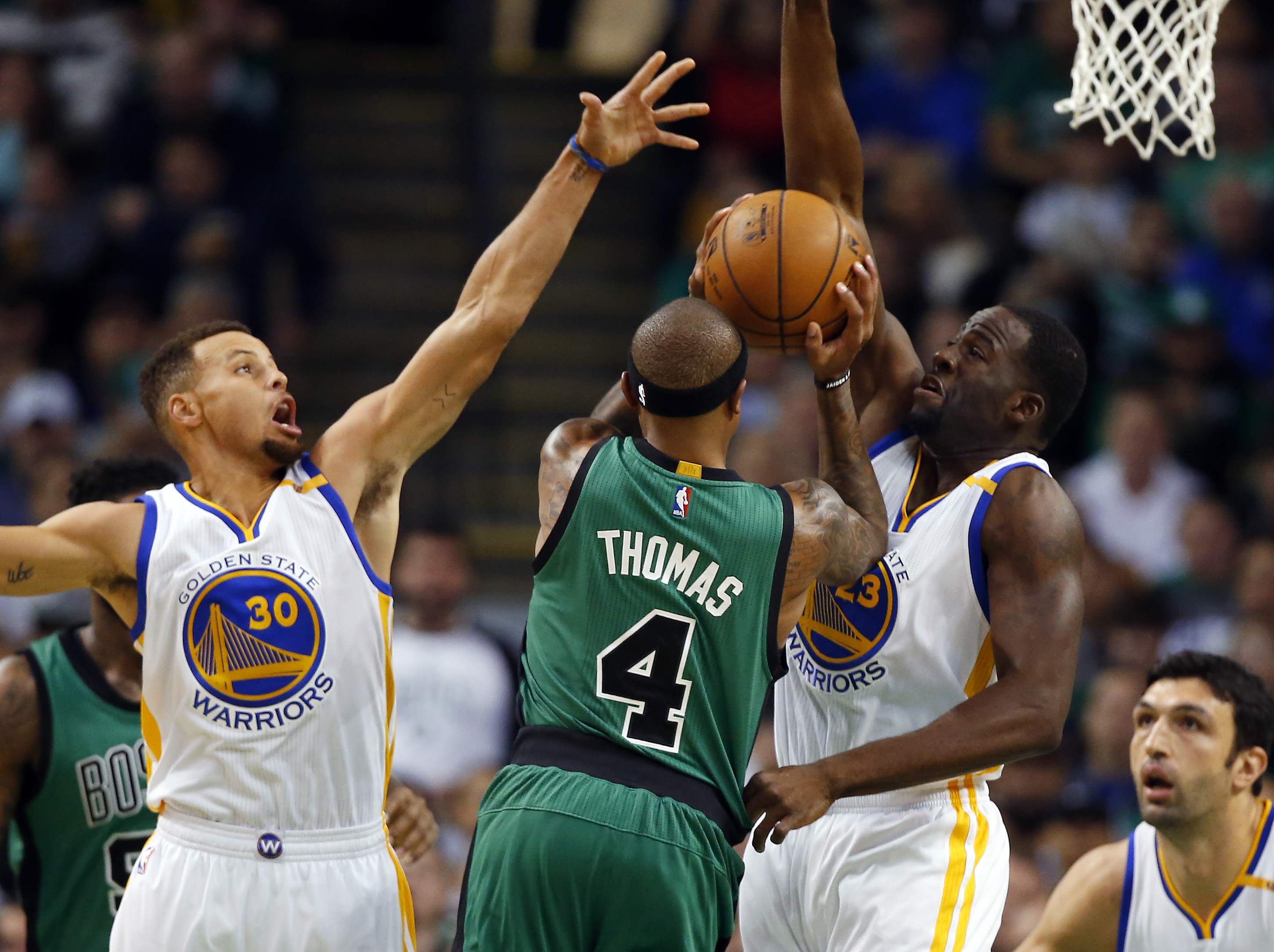 Nov 18, 2016; Boston, MA, USA; Boston Celtics guard Isaiah Thomas (4) tries to get between Golden State Warriors guard Stephen Curry (30) and Golden State Warriors forward Draymond Green (23) during the first half at TD Garden. Mandatory Credit: Winslow Townson-USA TODAY Sports